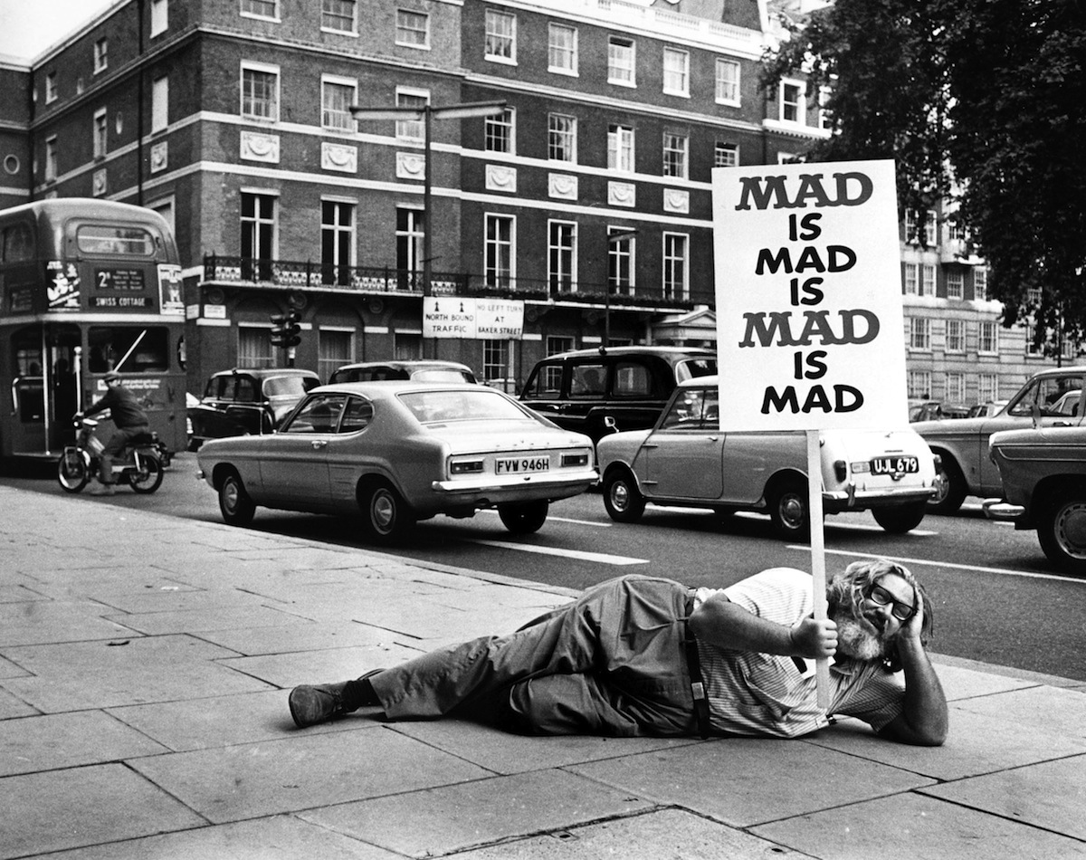 William M Gaines, the publisher of 'Mad' Magazine, lies on the pavement during a promotional tour in London on Sept. 2, 1971