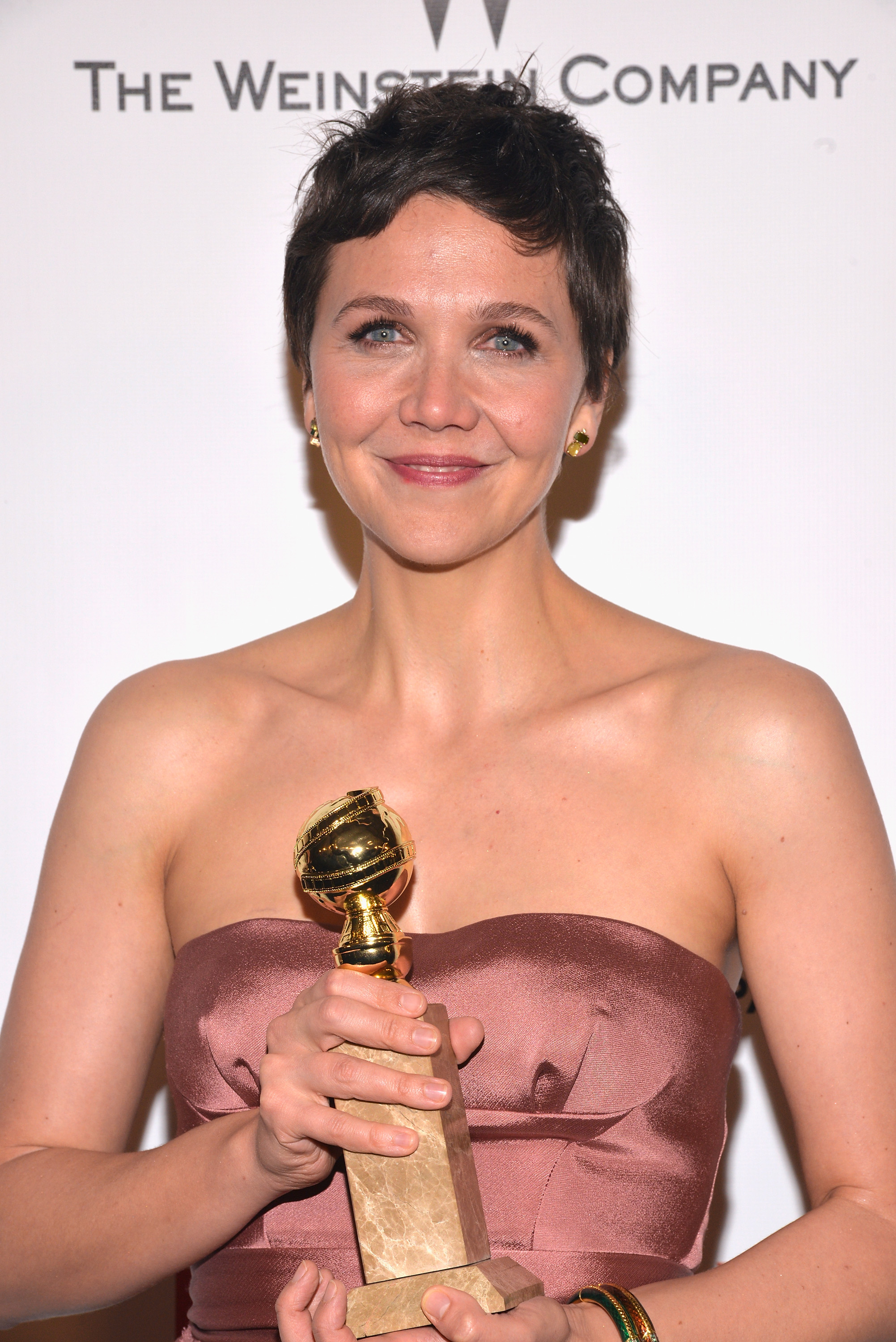 Maggie Gyllenhaal celebrates her win at the 2015 Weinstein Company and Netflix Golden Globes After Party on Jan. 11, 2015 in Beverly Hills, Calif.