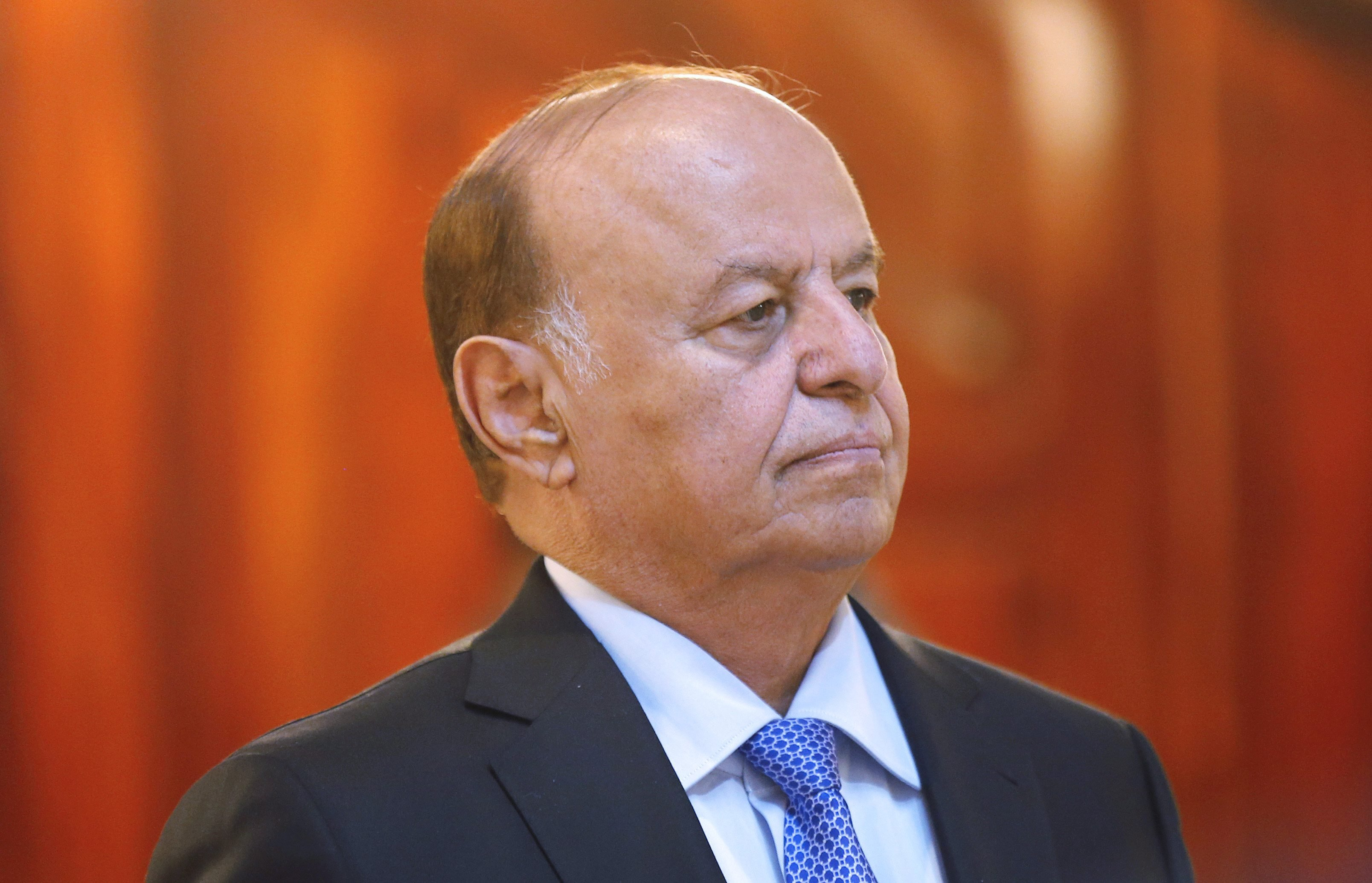 Yemen's President Abdel Rabbo Mansour Hadi stands during a reception ceremony during the holy fasting month of Ramadan at the Republican Palace in the Yemeni capital, Sana'a, on July 7, 2014