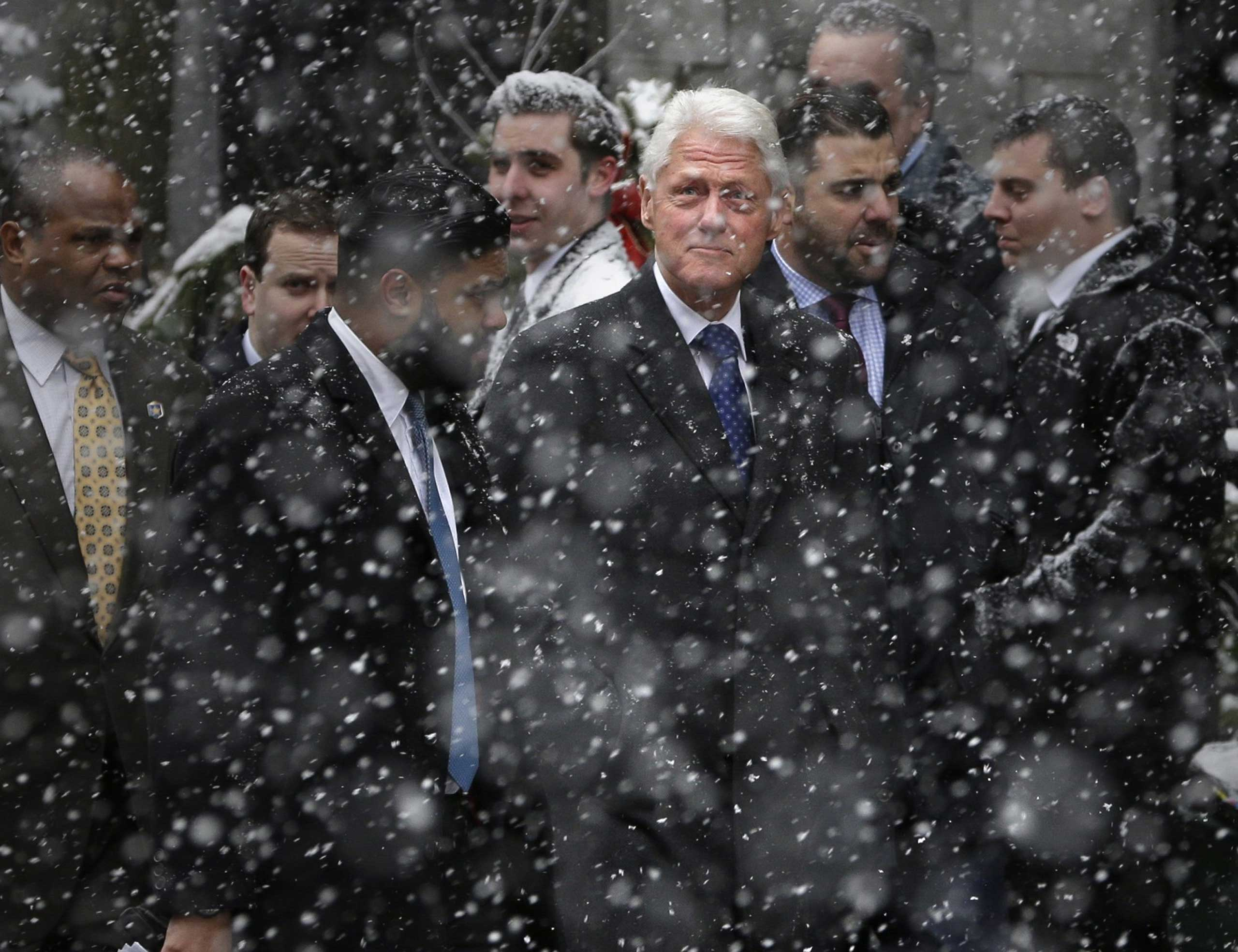 Former United States President Bill Clinton arrives for Mario Cuomo's funeral at the Church of St. Ignatius Loyola in New York on Jan. 6, 2015.