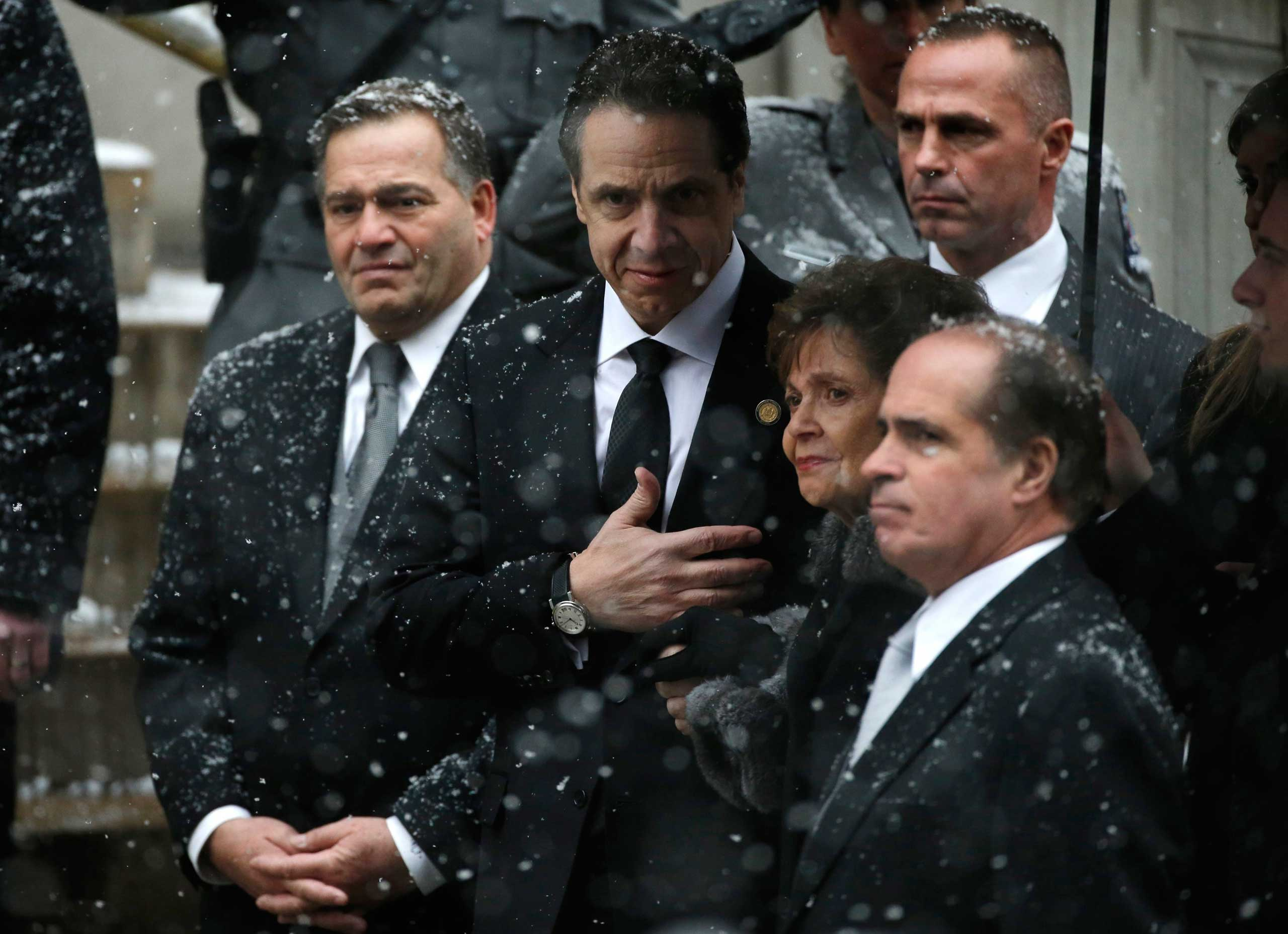 New York Governor Andrew Cuomo stands with his mother Matilda and other members of his family as he watches the casket of his late father former New York Governor Mario Cuomo being carried into St. Ignatius Loyola Church for funeral service in New York on Jan. 6, 2015.