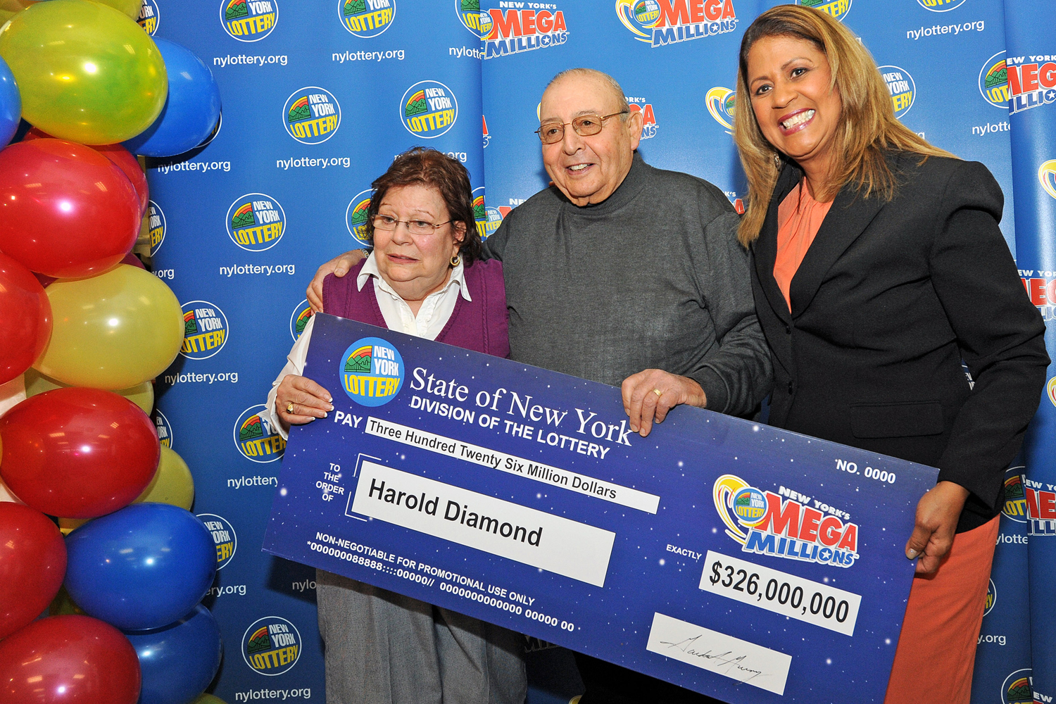 Harold Diamond and his wife Carol receive their ceremonial check from Yolanda Vega at the Valero gas station in the Town of Wallkill, N.Y., on Monday, Jan. 12, 2015.