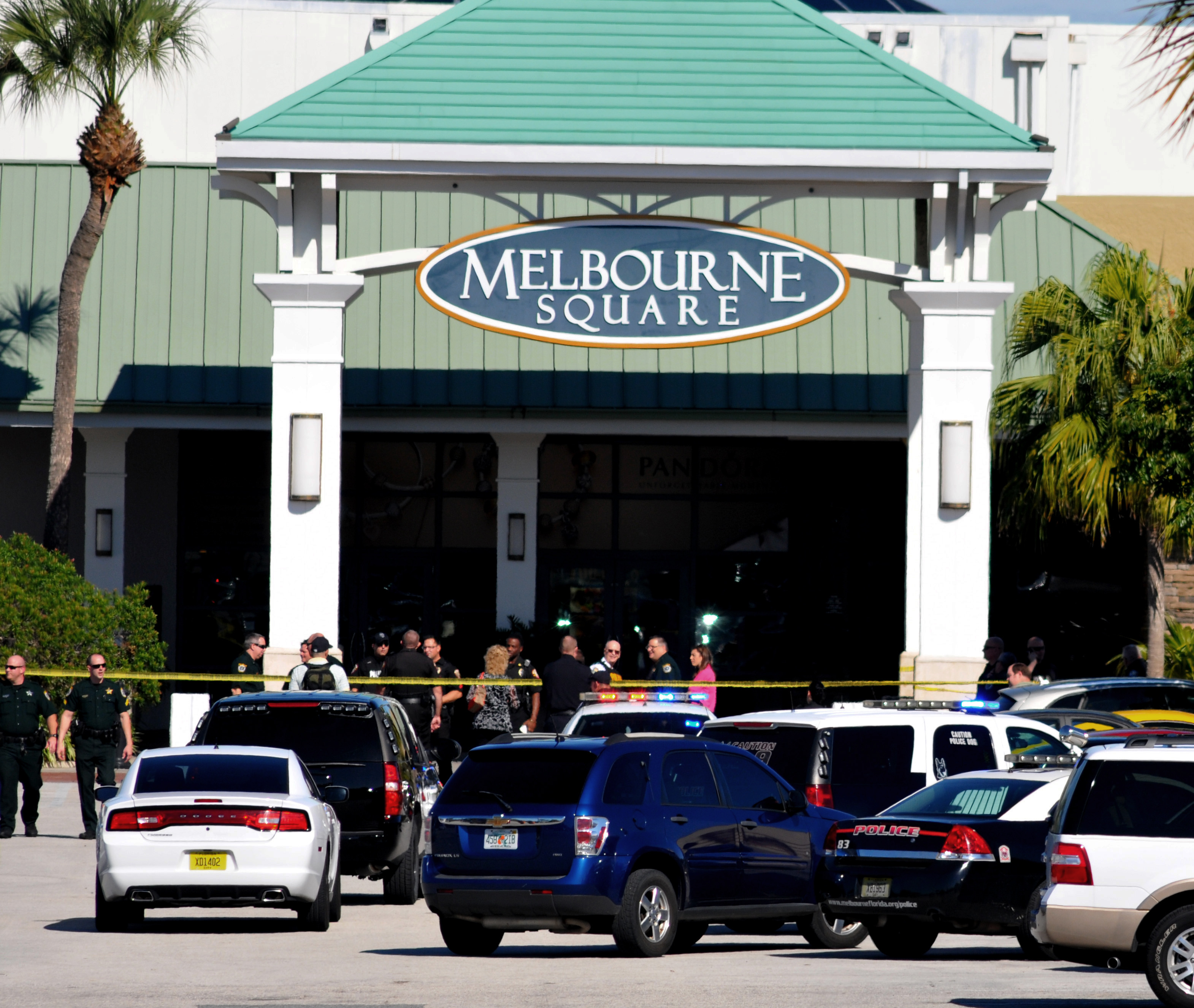 Emergency personnel respond to the scene of a shooting at the Melbourne Square Mall on Jan 17, 2015 in Melbourne, Fla.