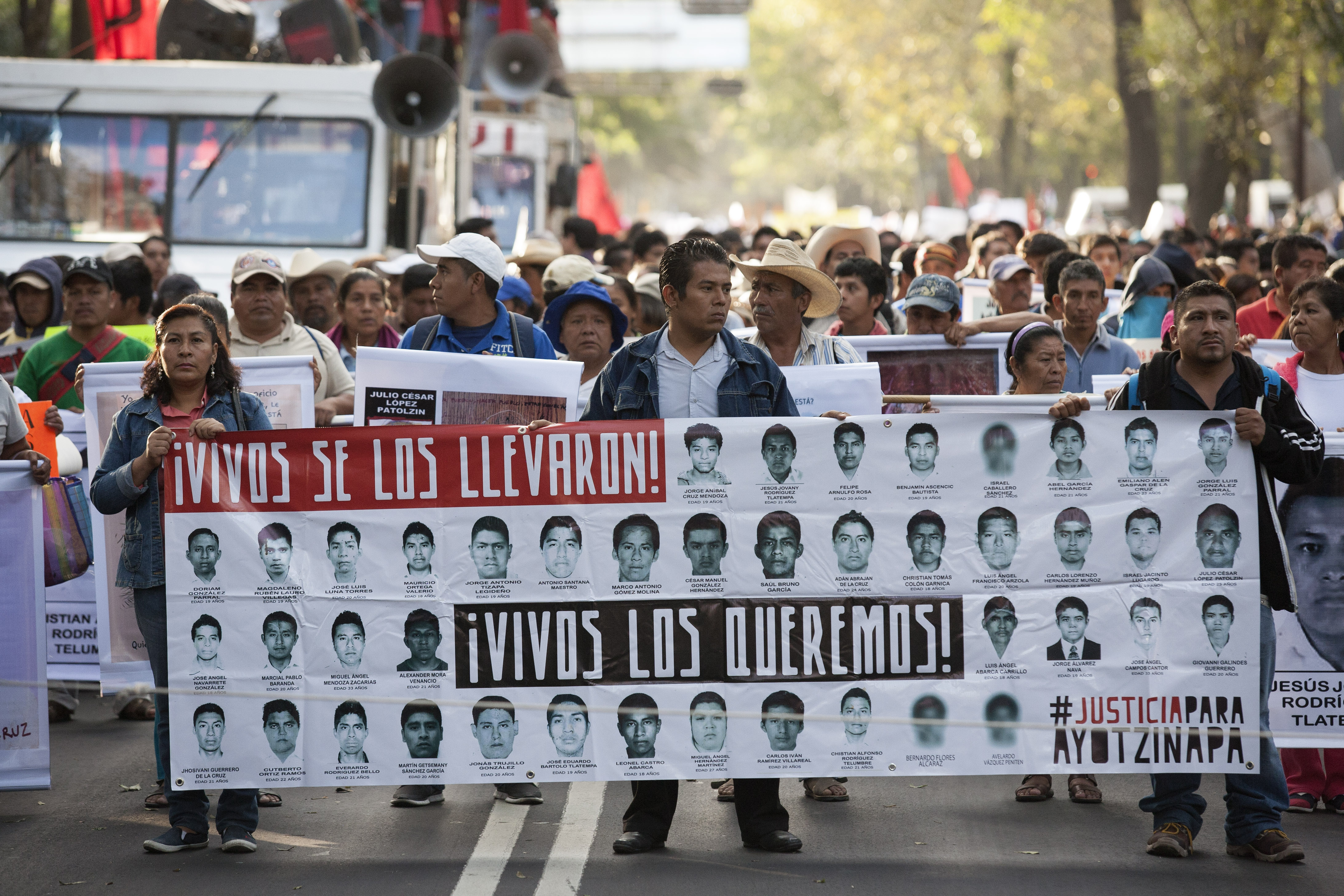Protestors and family of 43 missing students from Guerrero State in Mexico march to protest the government and demand answers of the missing students on Nov. 5, 2014 in Mexico, City.