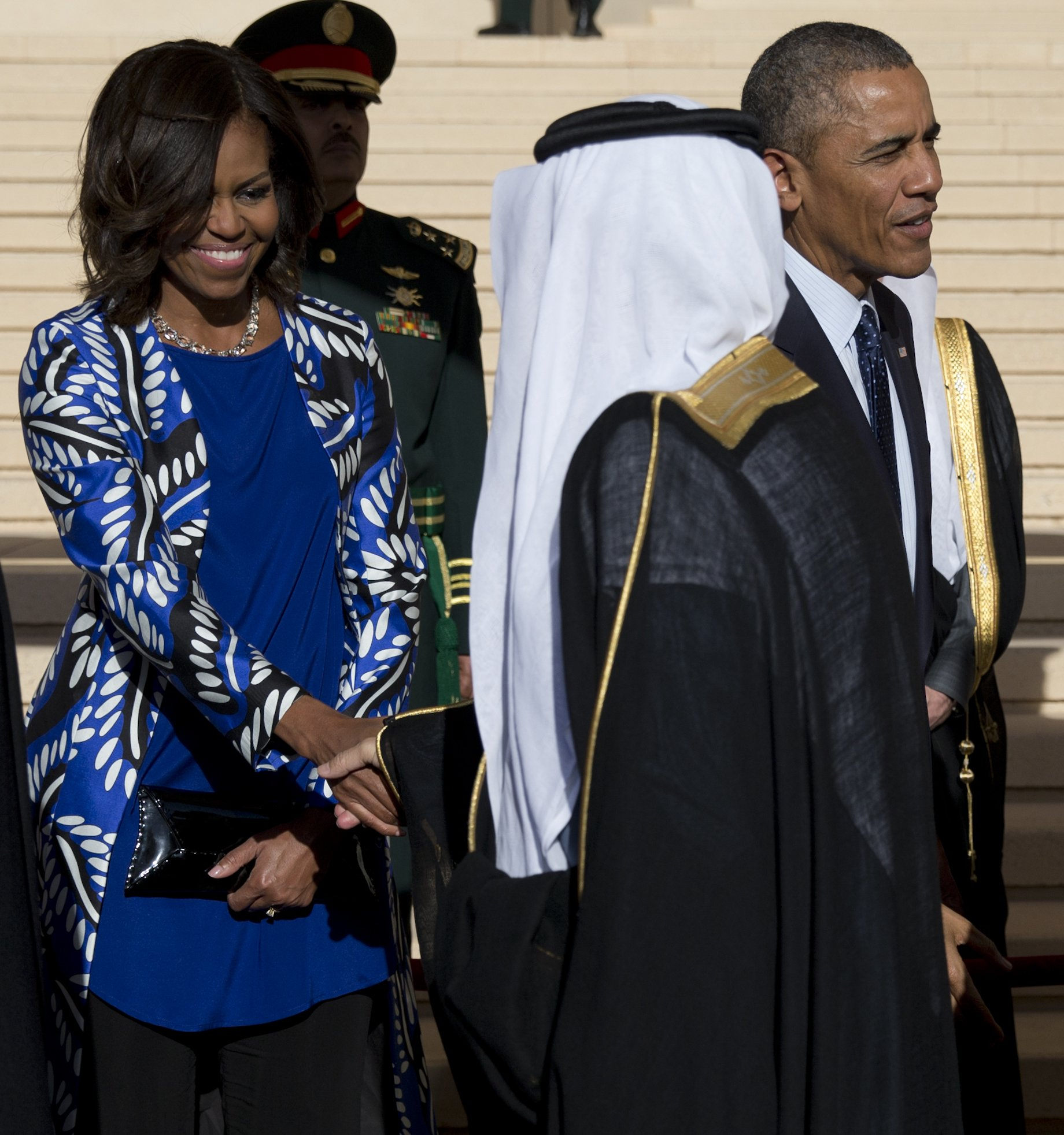 President Barack Obama and first lady Michelle Obama stand with new Saudi King Salman bin Abdul Aziz for a receiving line as they arrive at King Khalid International Airport, in Riyadh, Saudi Arabia on Jan. 27, 2015.