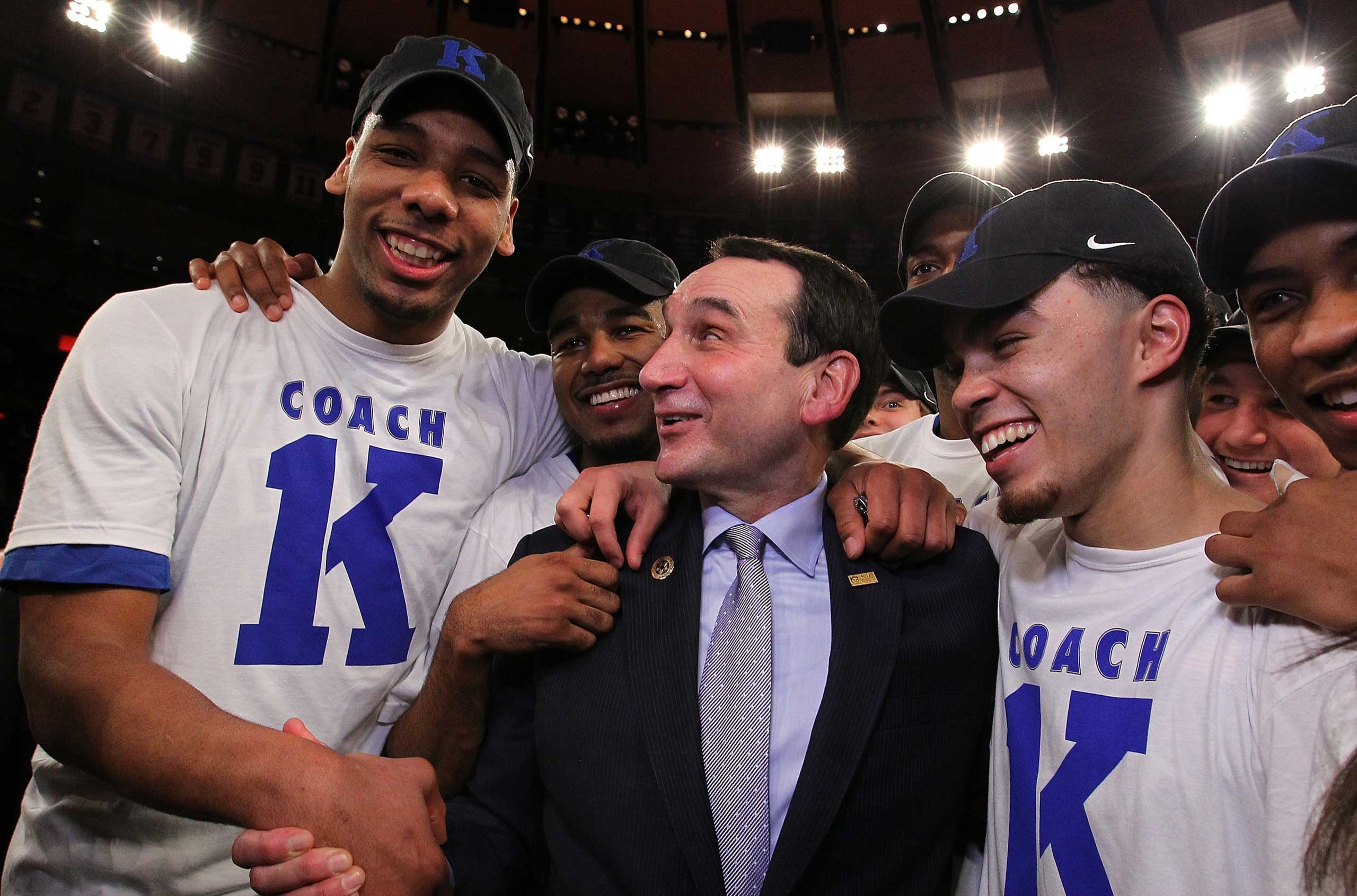 Head coach Mike Krzyzewski of the Duke Blue Devils celebrates with teamates after his 1000th career win after the game against the St. John's Red Storm at Madison Square Garden on January 25, 2015 in New York City.
