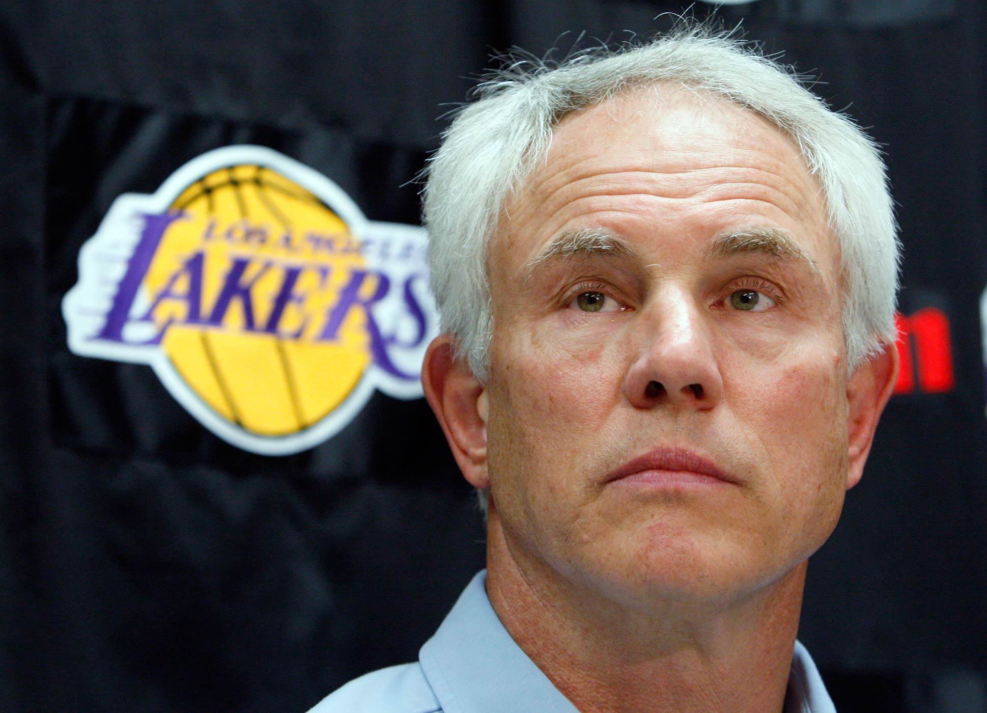 Los Angeles Lakers general manager Mitch Kupchak talks to reporters at the team's practice facility in El Segundo, Calif., June 23, 2010.