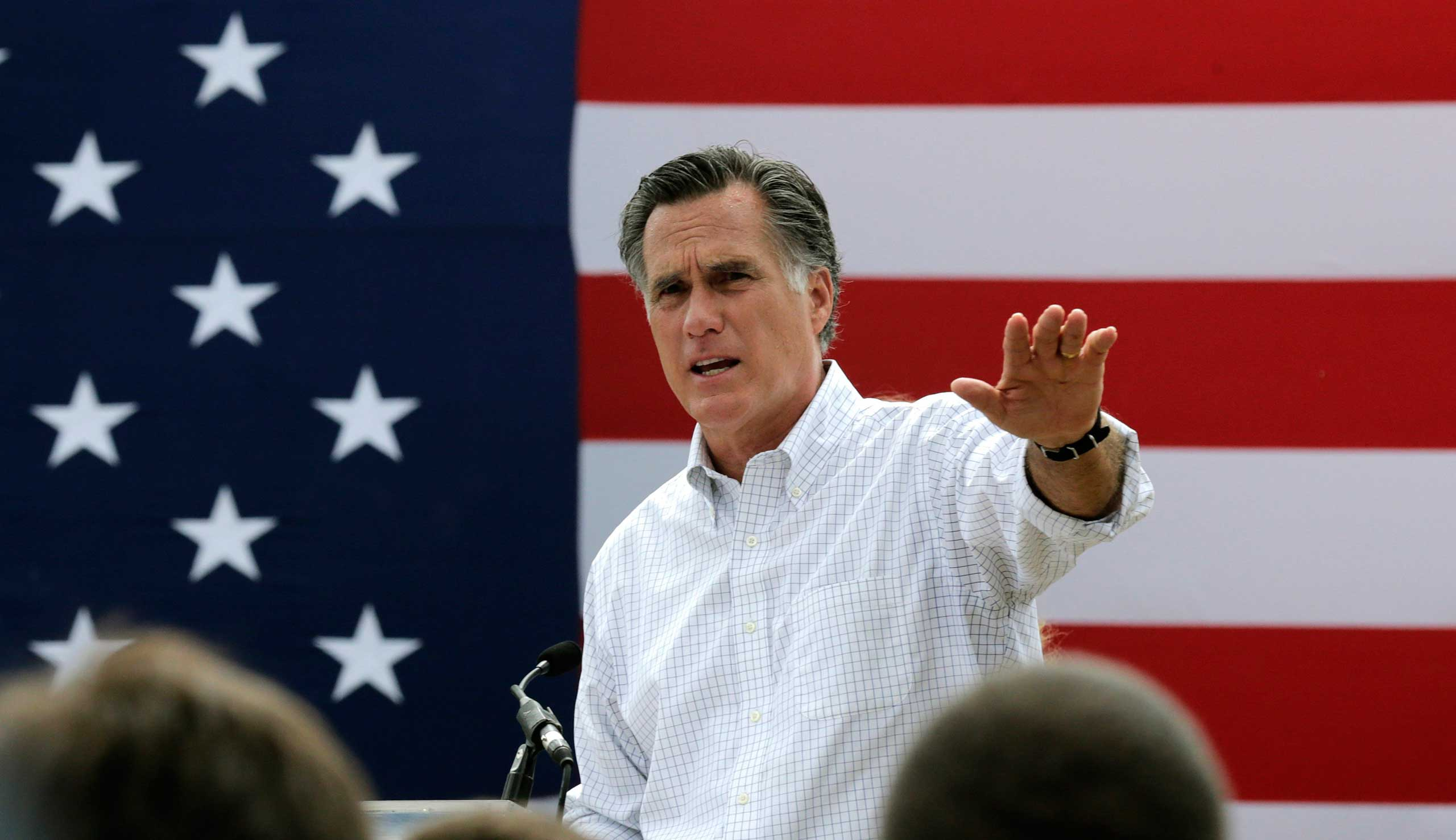 Mitt Romney, the former Republican presidential nominee, addresses a crowd of supporters while introducing New Hampshire Senate candidate Scott Brown at a farm in Stratham, N.H. on July 2, 2014.