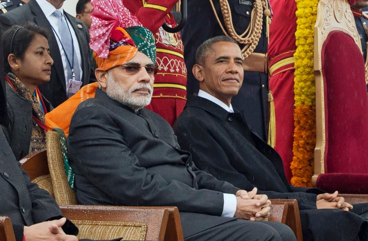 President Barack Obama and Indian Prime Minister Narendra Modi watch a parade and award ceremony during India's Republic Day celebration in New Delhi.