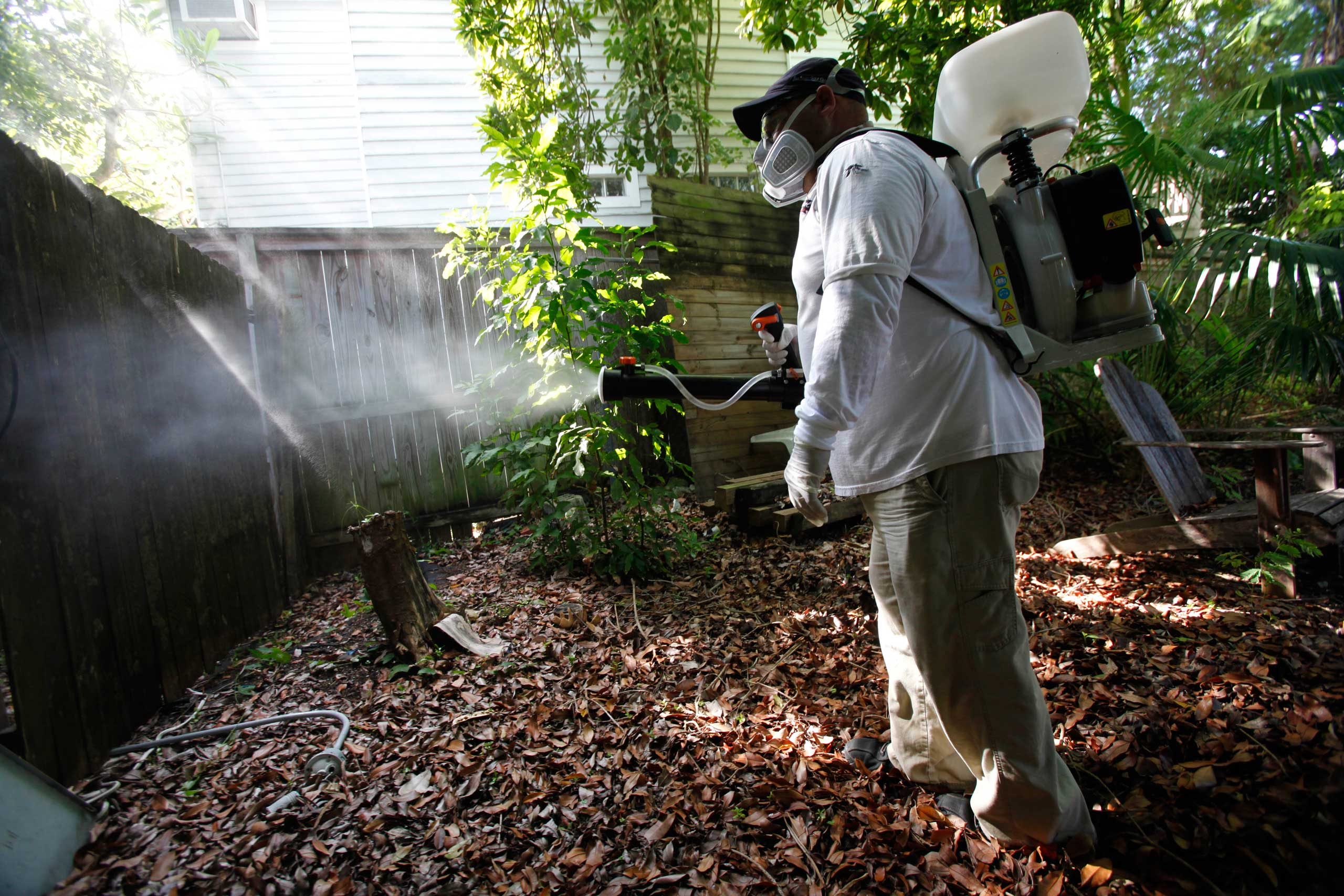 Jason Garcia, a field inspector with the Florida Keys Mosquito Control District, tests a sprayer that could be used in the future to spray pesticides to control mosquitos in Key West, Fla., on Oct. 4, 2012