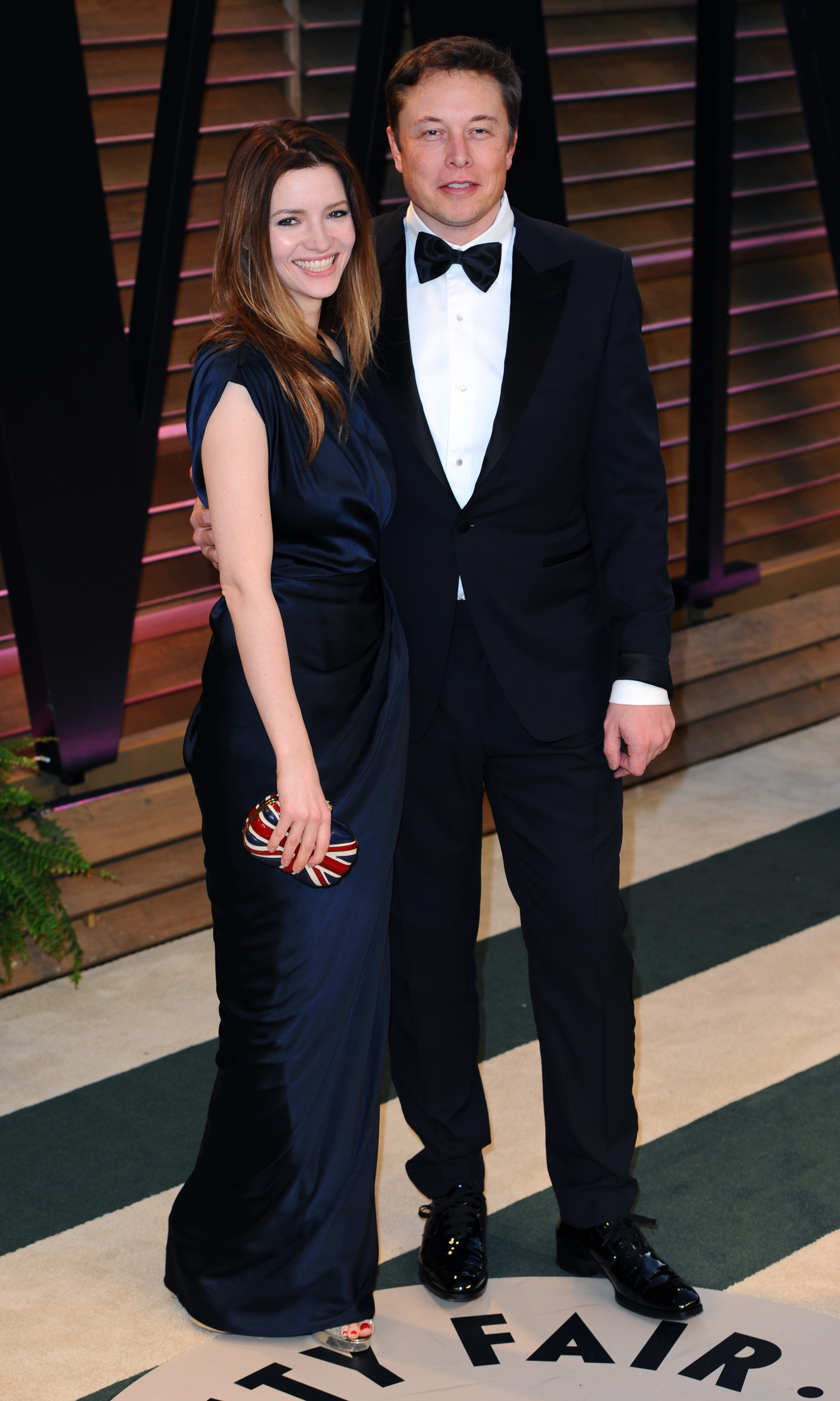 Talulah Riley (L) and CEO of Tesla Motors Elon Musk attend the 2014 Vanity Fair Oscar Party hosted by Graydon Carter on March 2, 2014 in West Hollywood, California.