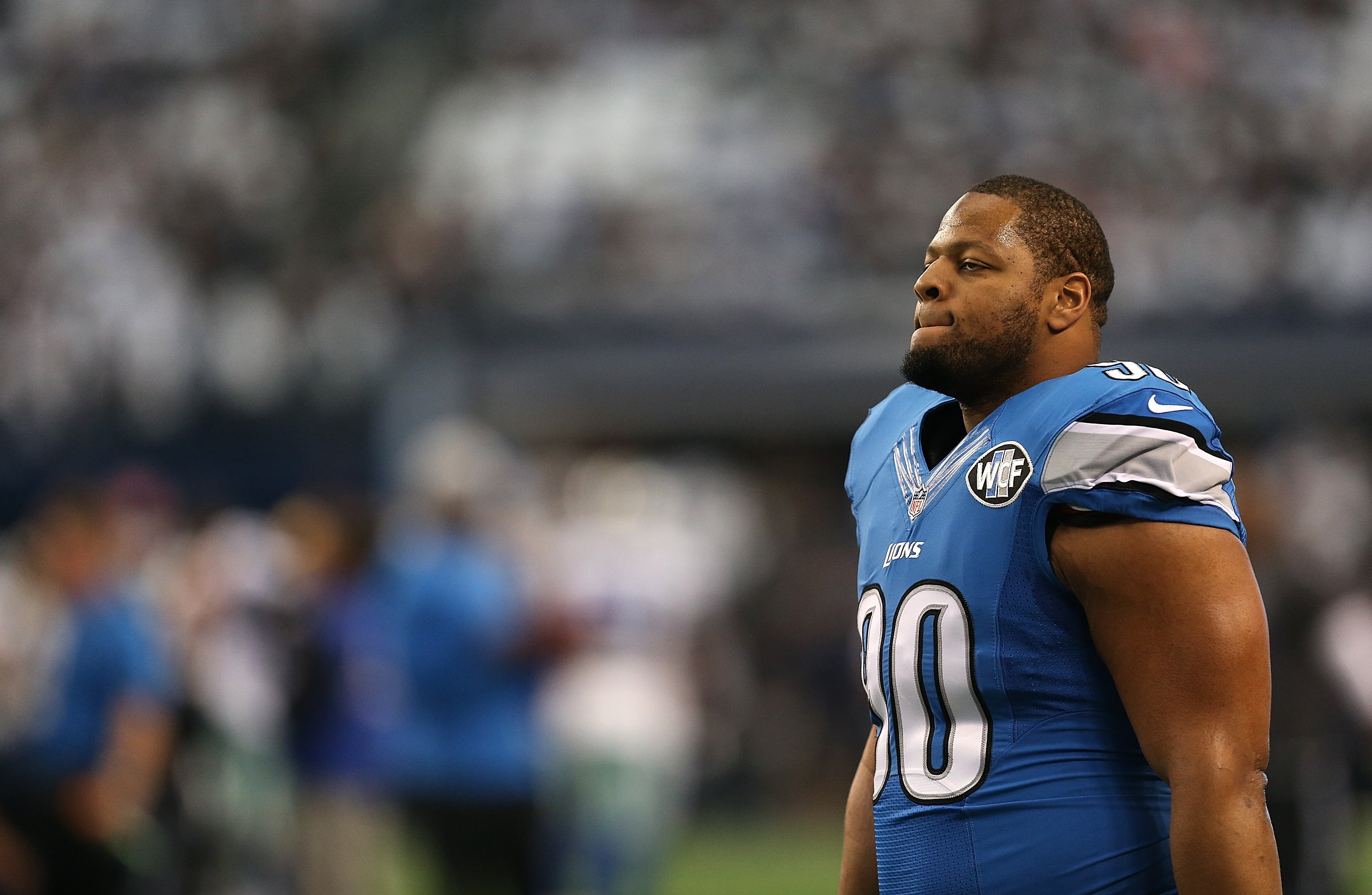 Ndamukong Suh of the Detroit Lions looks on before a NFC Wild Card Playoff game against the Dallas Cowboys at AT&T Stadium on Jan. 4, 2015 in Arlington, Texas.