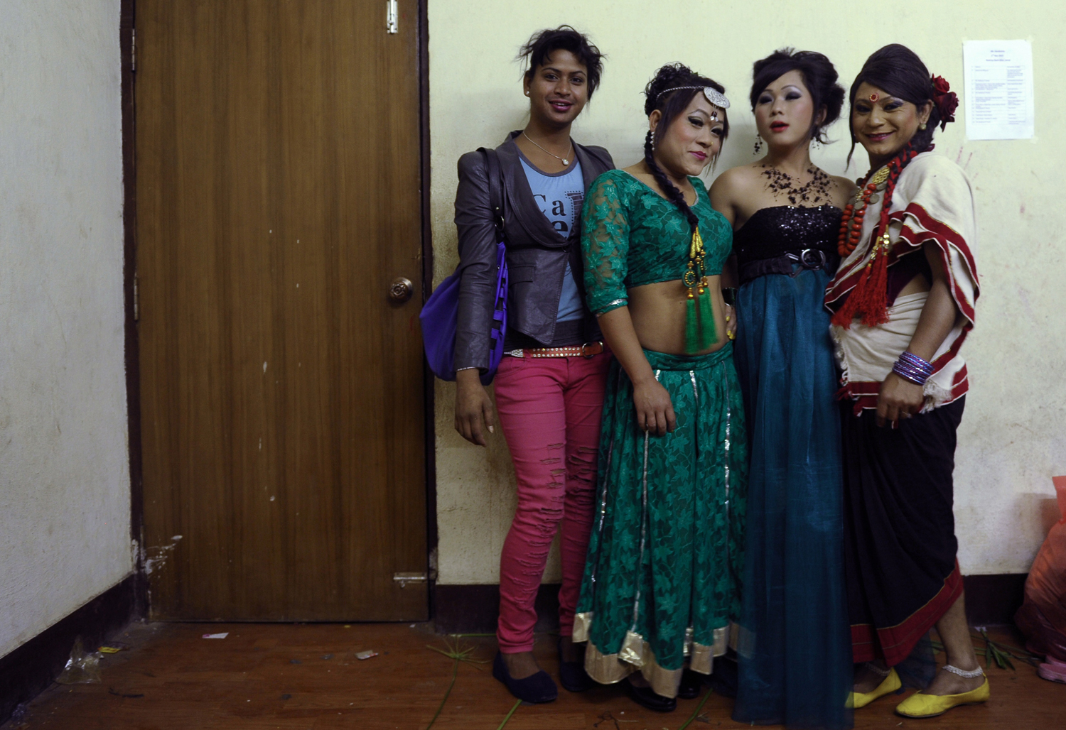 Nepalese transgendered performers pose for photographs backstage in Kathmandu on November 2, 2013.