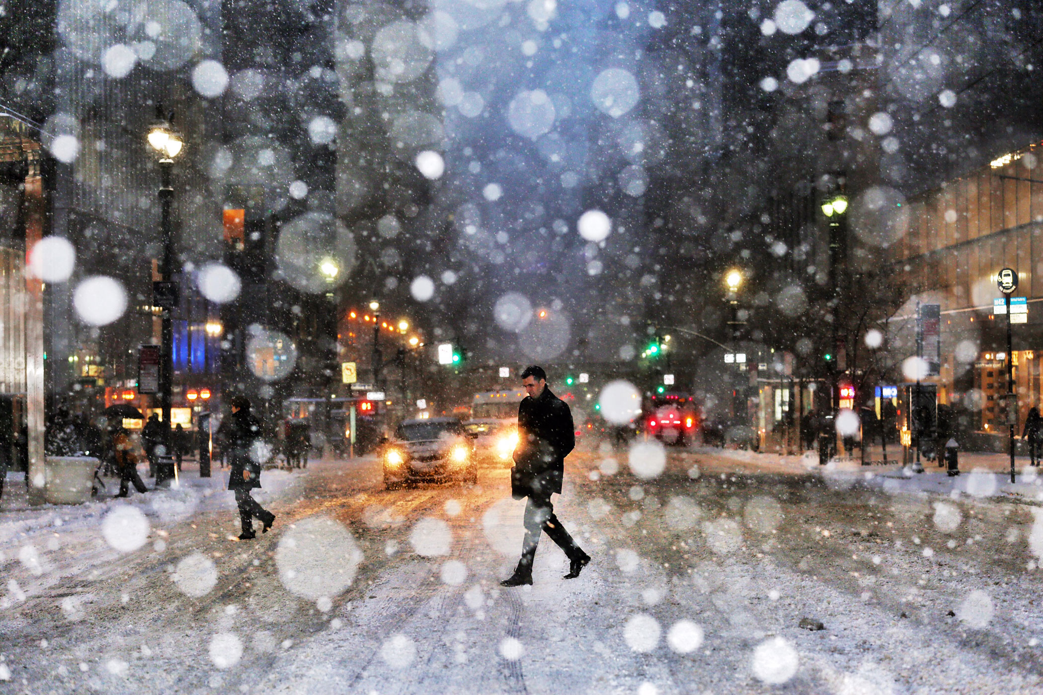 A man crosses the street in New York City during a snow storm in New York City on Jan. 26, 2015.