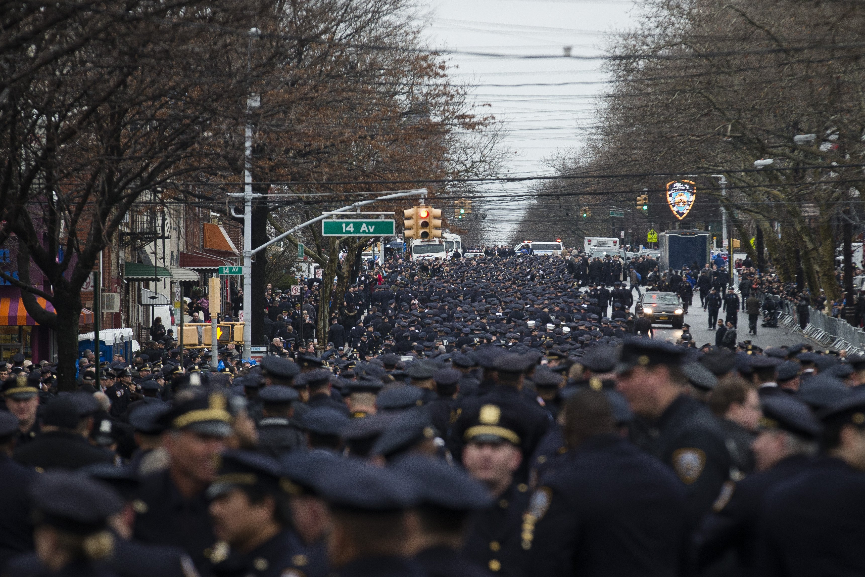 Police officers from across the country gather for the funeral of New York Police Department Officer Wenjian Liu at Aievoli Funeral Home on Jan. 4, 2015, in the Brooklyn borough of New York.