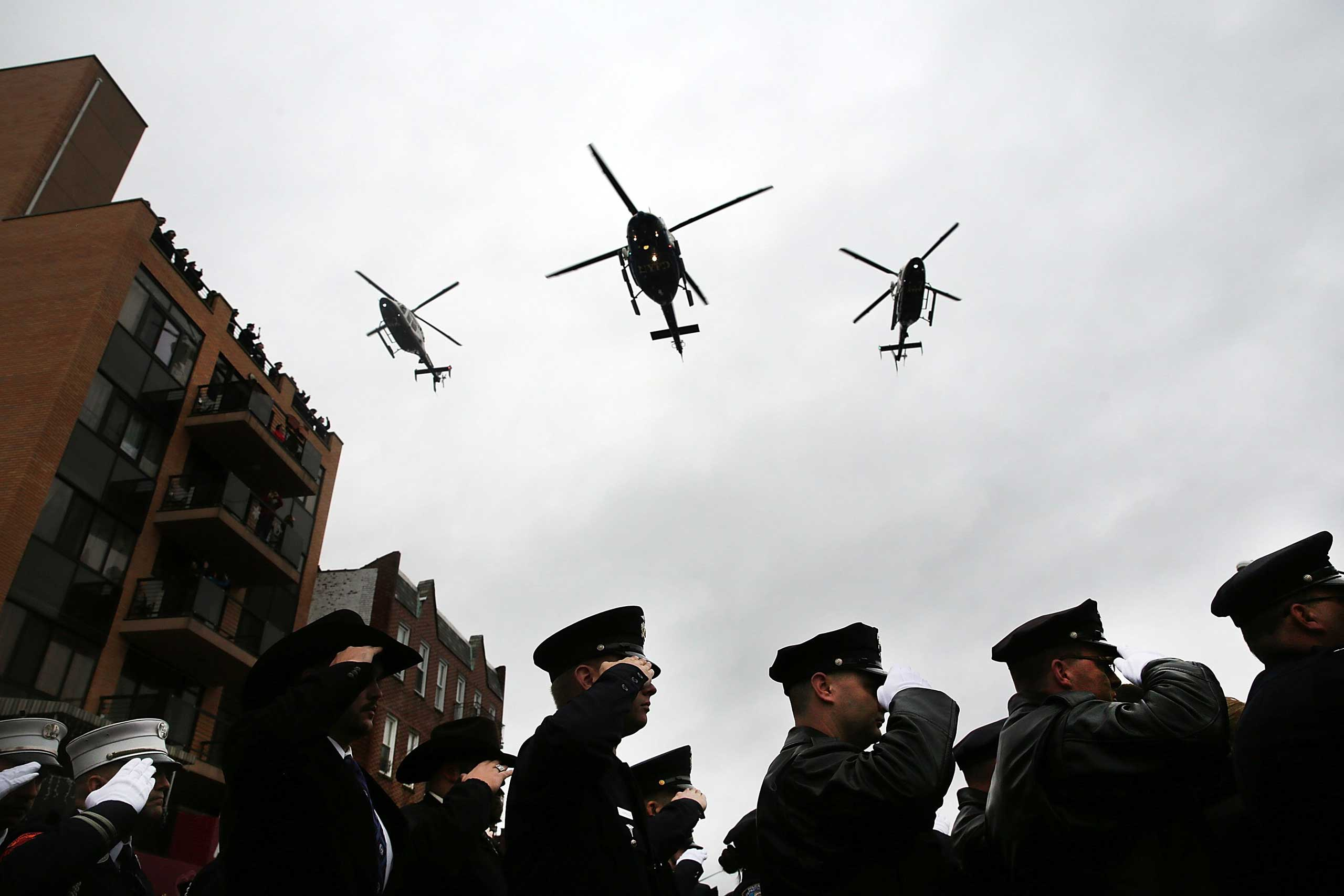 Police helicopters do a fly over at the conclusion of the funeral service for slain New York City Police Officer Wenjian Liu on Jan. 4, 2015 in New York.