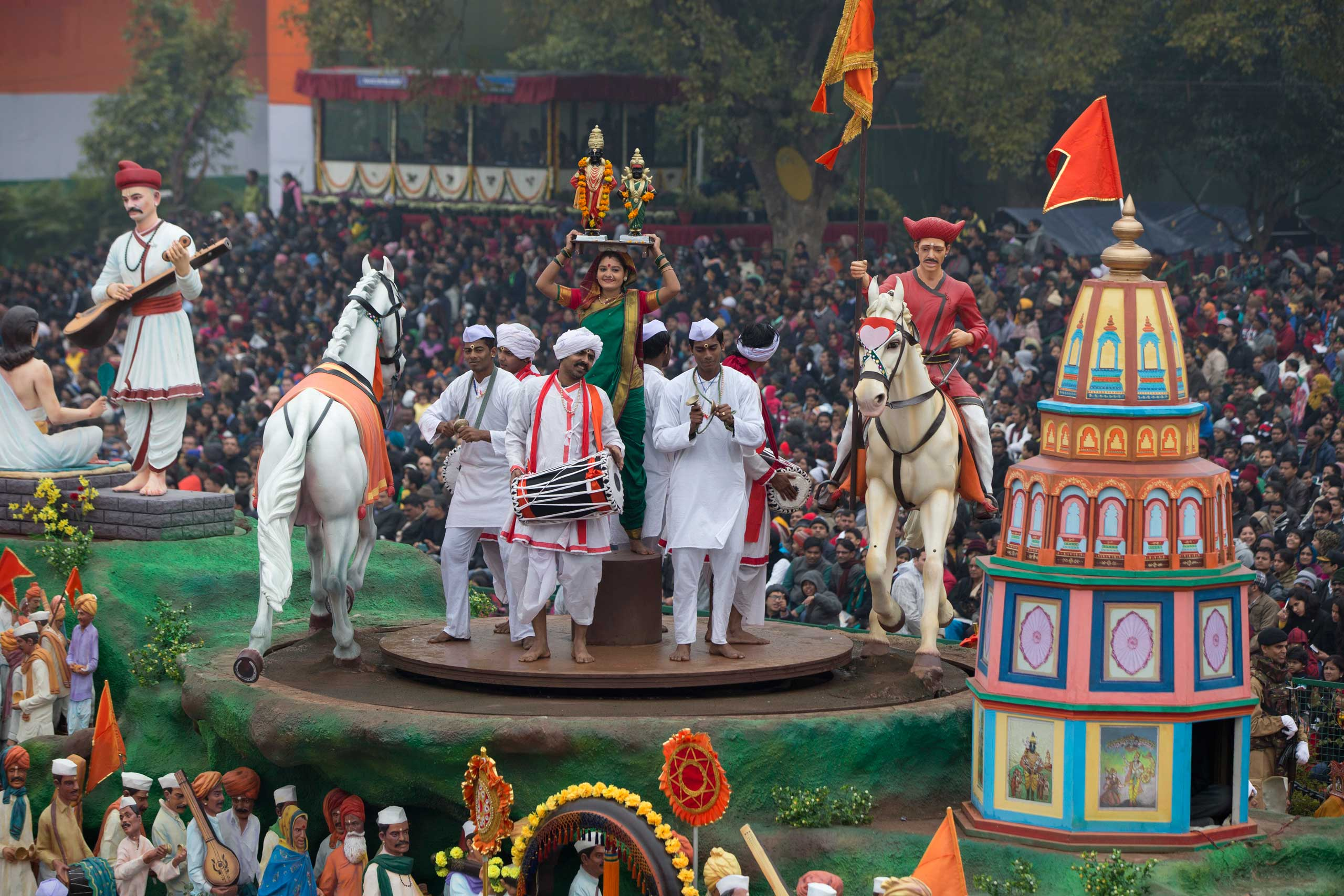 Performers spin around atop a float during the Republic Day Parade in New Delhi, Jan. 26, 2015.