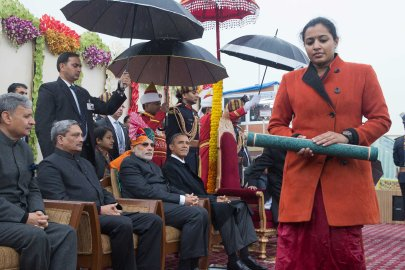 President Barack Obama and Indian Prime Minister Narendra Modi watch an award ceremony and parade from their viewing stand overlooking the Republic Day parade in New Delhi, Jan. 26, 2015.