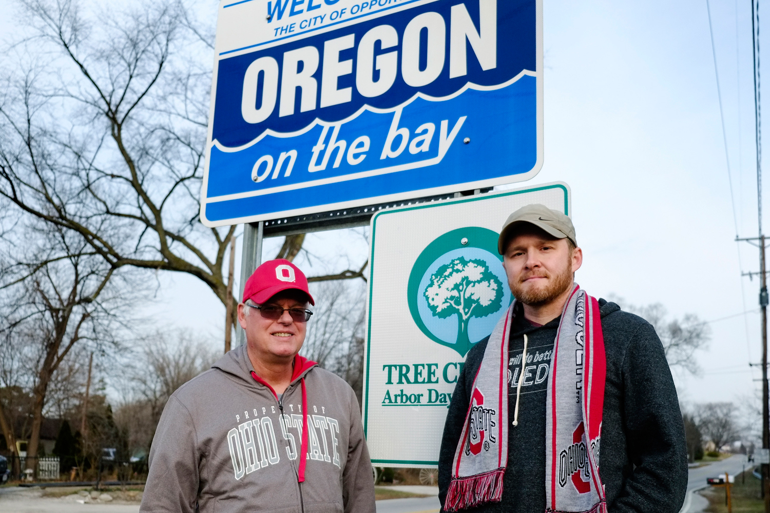 Standing at the Oregon, Ohio, city limits sign, Dick Squibb and his son Matt, who petitioned the city to change its name to show allegiance to the Ohio State Buckeyes, January 2, 2015.