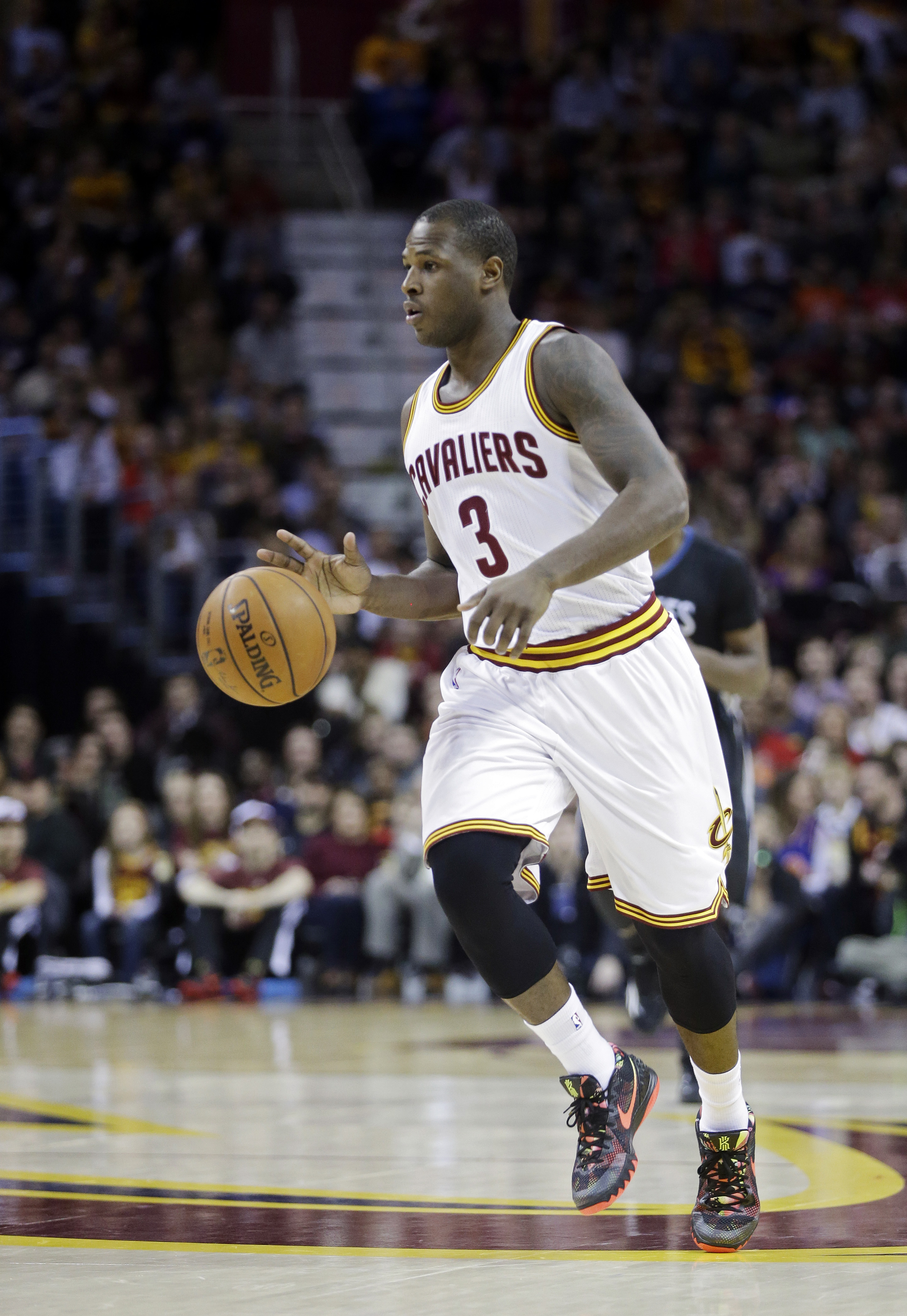 Cleveland Cavaliers' Dion Waiters (3) brings the ball up against the Minnesota Timberwolves in an NBA basketball game Tuesday, Dec. 23, 2014, in Cleveland.