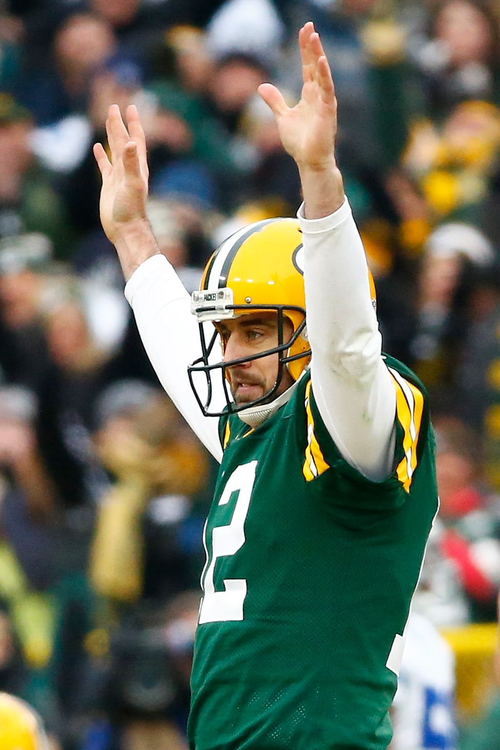 Aaron Rodgers of the Green Bay Packers reacts after completing a pass during the 2015 NFC Divisional Playoff game on Jan. 11, 2015 in Green Bay, Wisconsin.