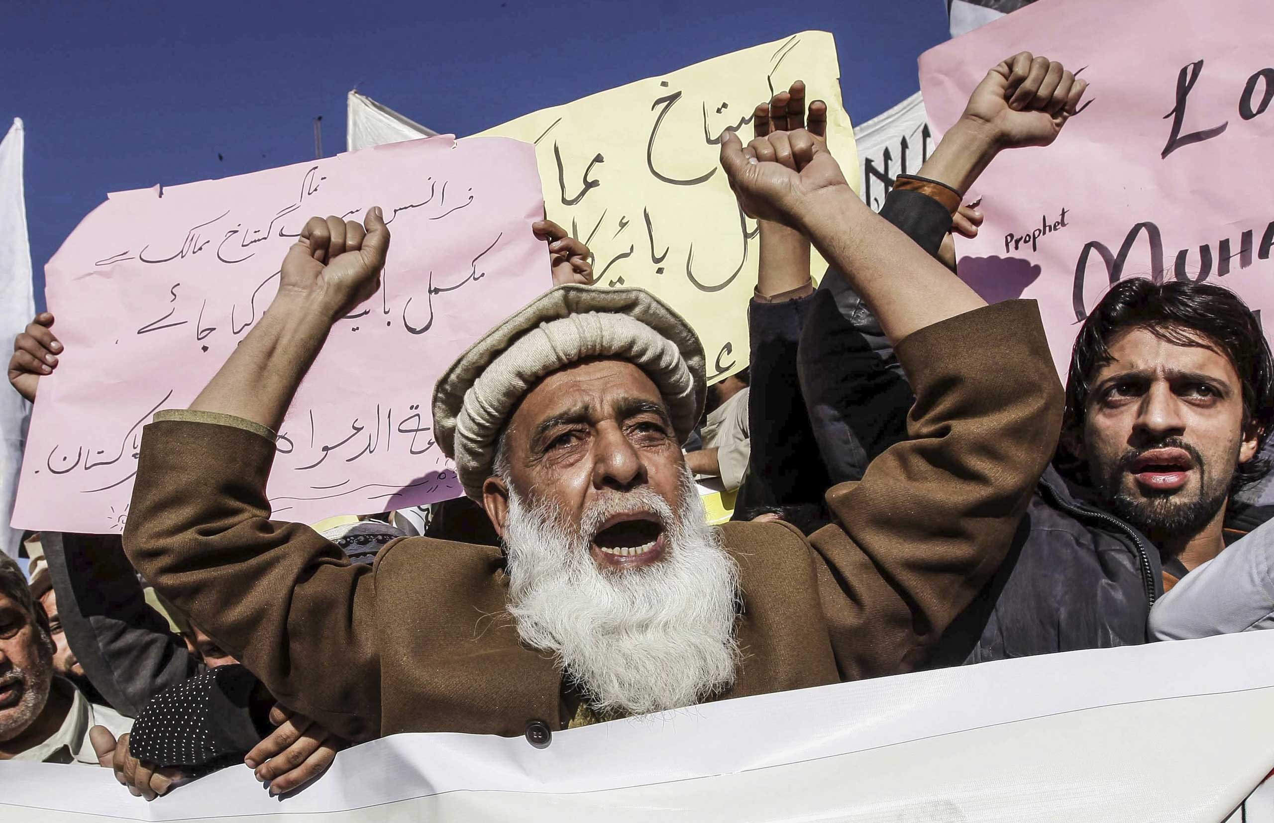 Supporters of banned Islamic charity Jamat-ud-Dawa protest controversial French magazine Charlie Hebdo's decision to publish a depiction of the Prophet Muhammad in Peshawar, Pakistan on Jan. 16, 2015.