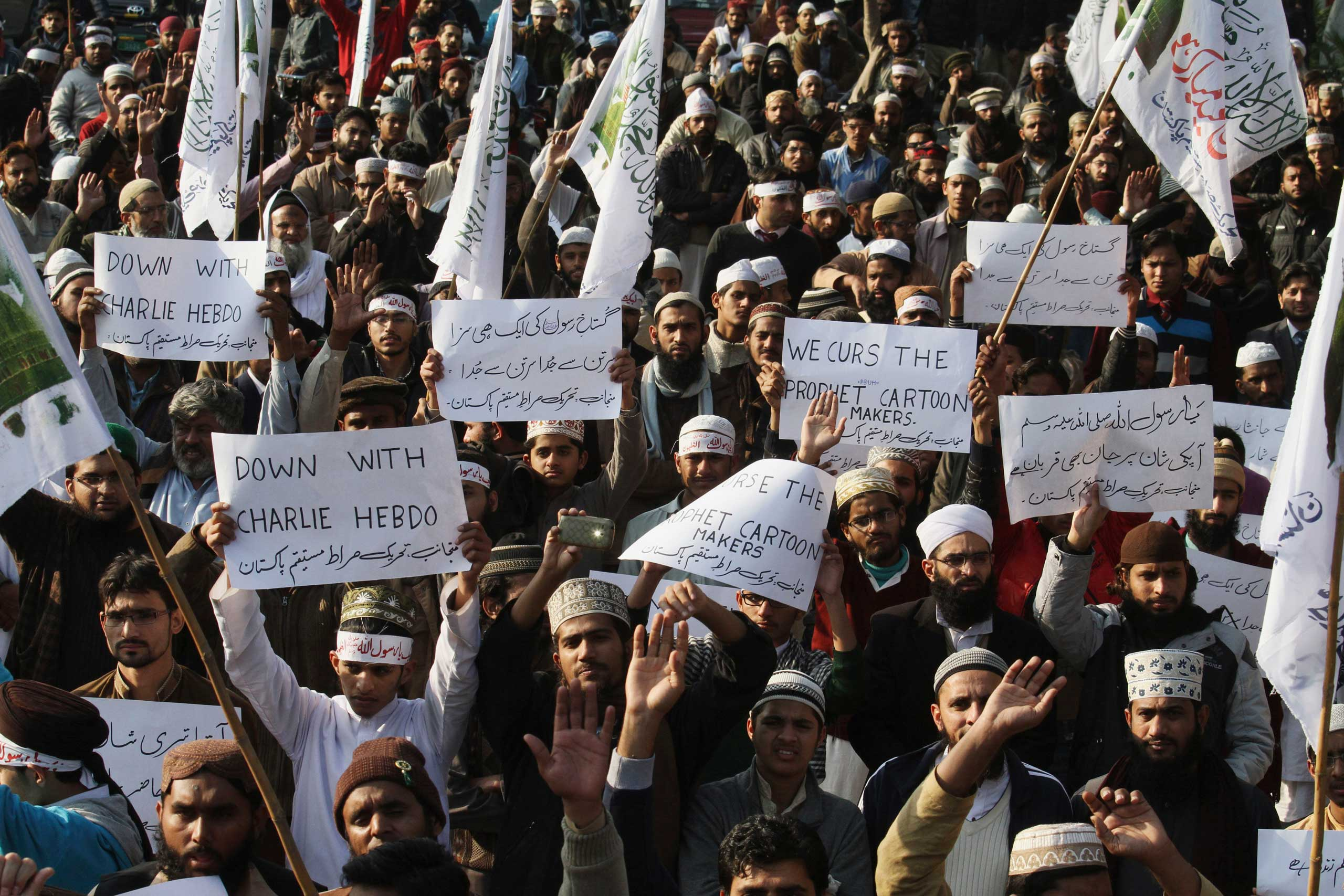Supporters of a Pakistani religious group rally to protest against caricatures published in the French magazine Charlie Hebdo, in Lahore, Pakistan on  Jan. 15, 2015.