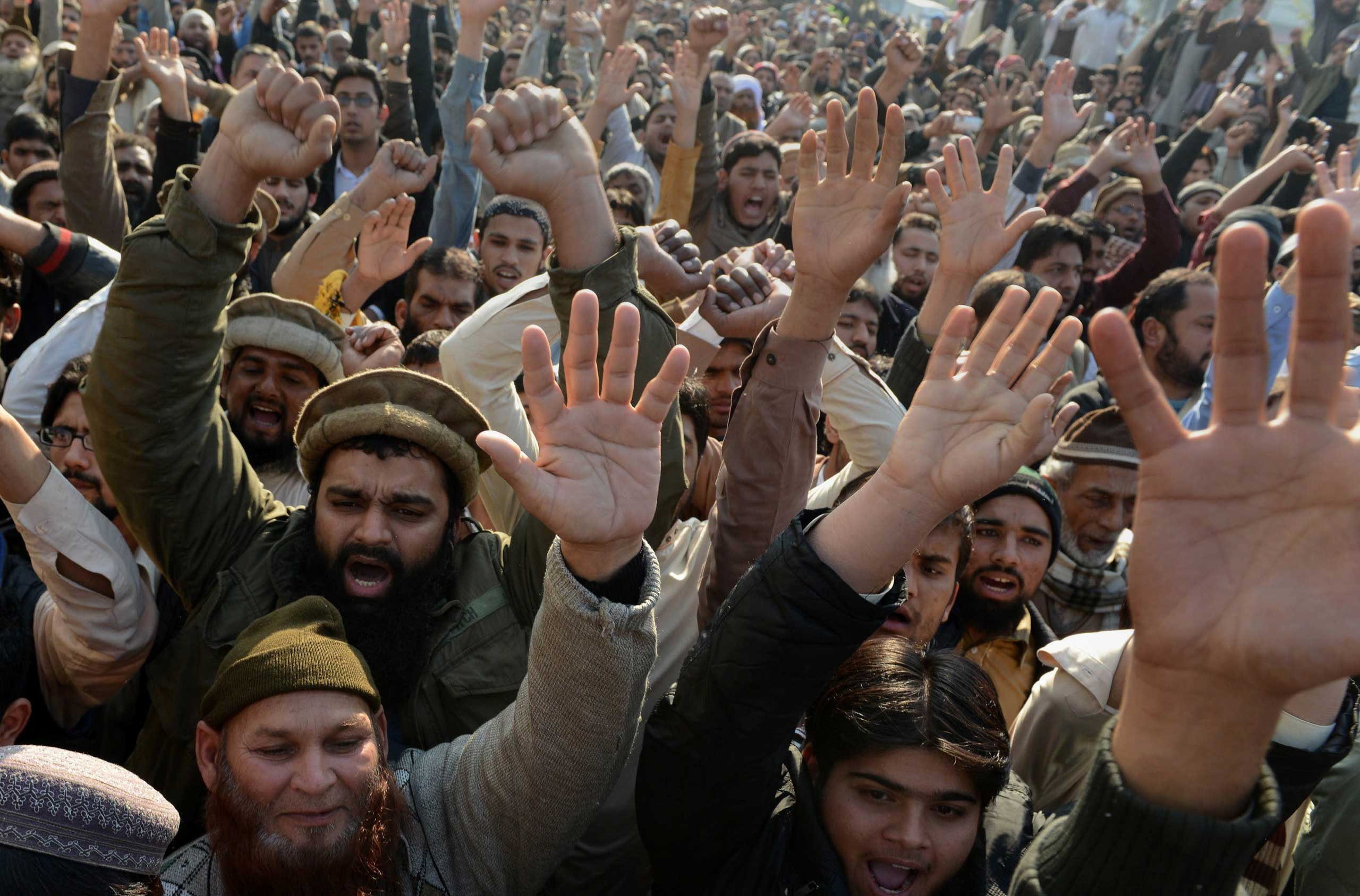 Pakistani protesters shout slogans against the printing of satirical sketches of the Prophet Muhammad by French magazine Charlie Hebdo during a demonstration in Lahore, Pakistan on Jan. 16, 2015.