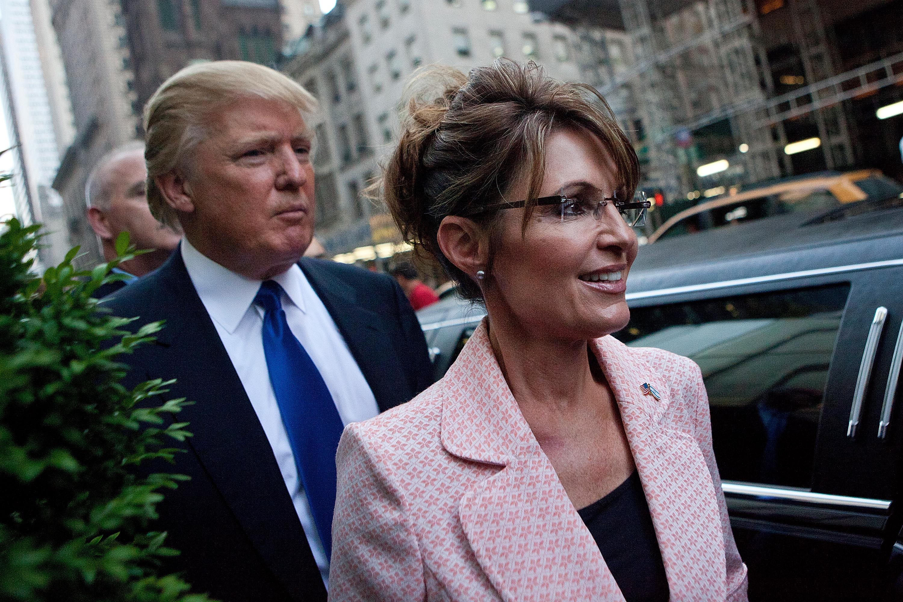 Former U.S. Vice presidential candidate and Alaska Governor Sarah Palin and Donald Trump walk towards a limo after leaving Trump Tower at 56th Street and 5th Avenue on May 31, 2011 in New York City.