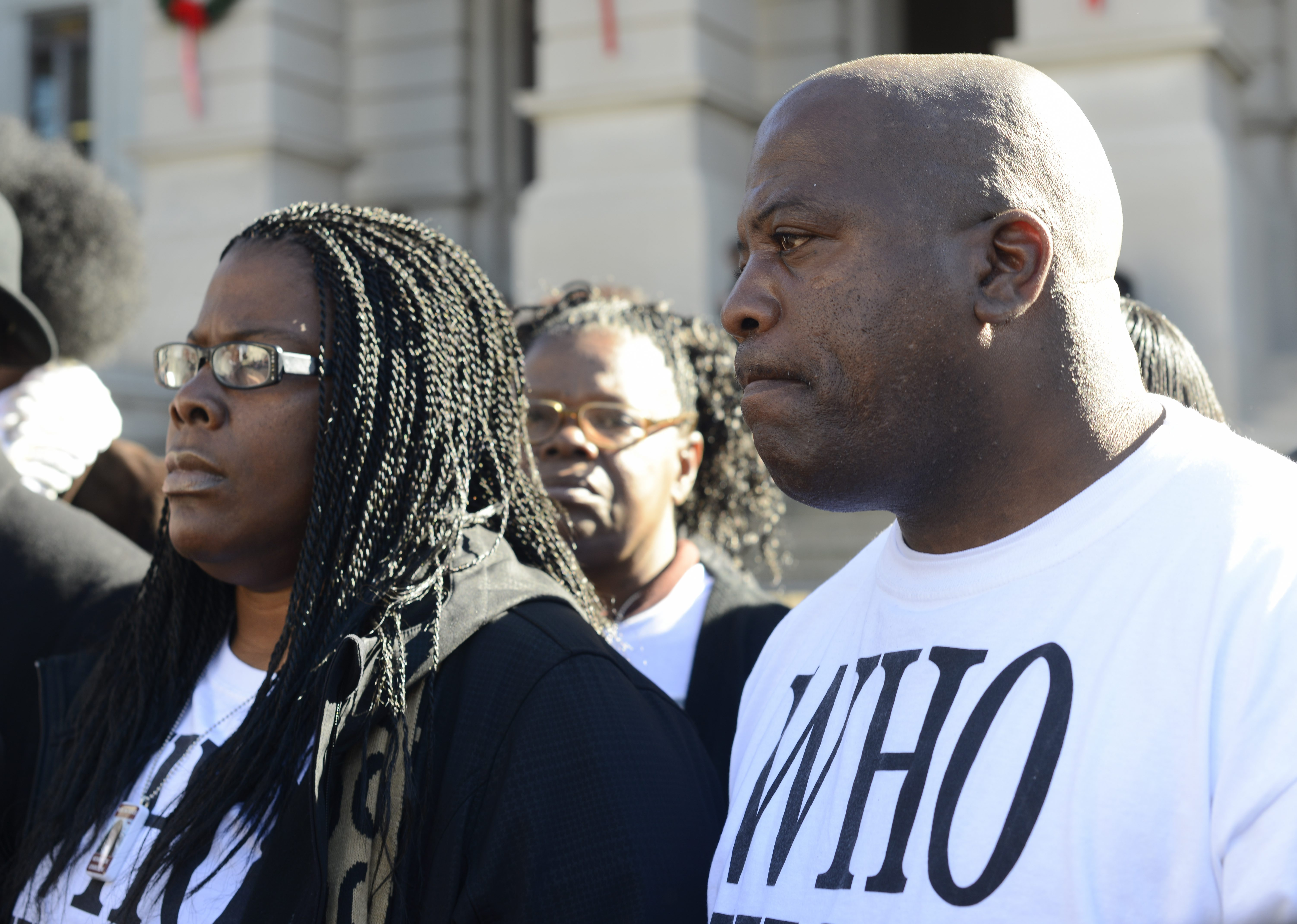 Jacqueline Johnson (left) and her husband Kenneth (right) participate in a rally on behalf of their dead son Kendrick Johnson at the Georgia State Capitol in Atlanta on  Dec. 11, 2013.