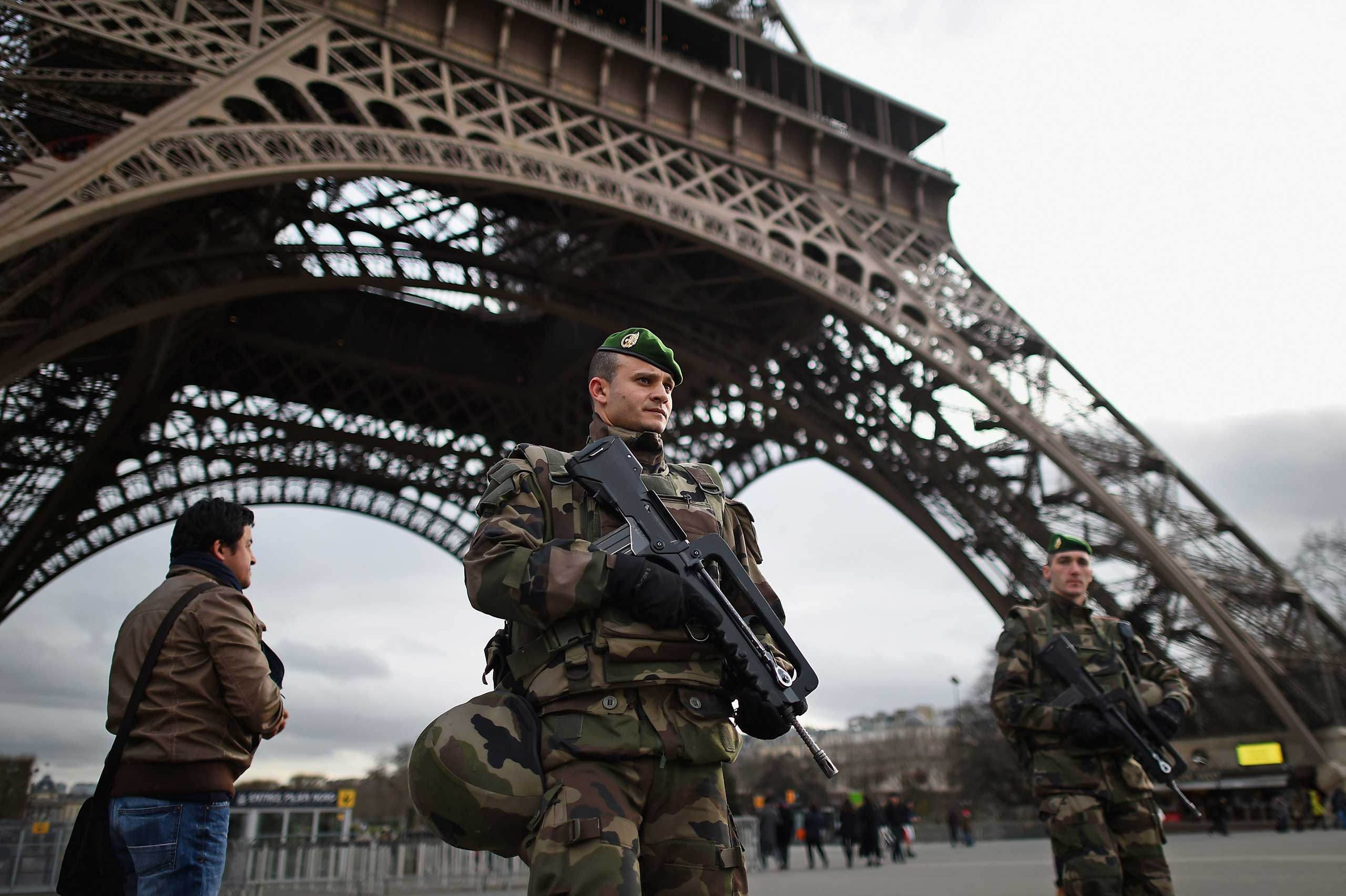French troops patrol around the Eiffel Tower in Paris on Jan. 12, 2015