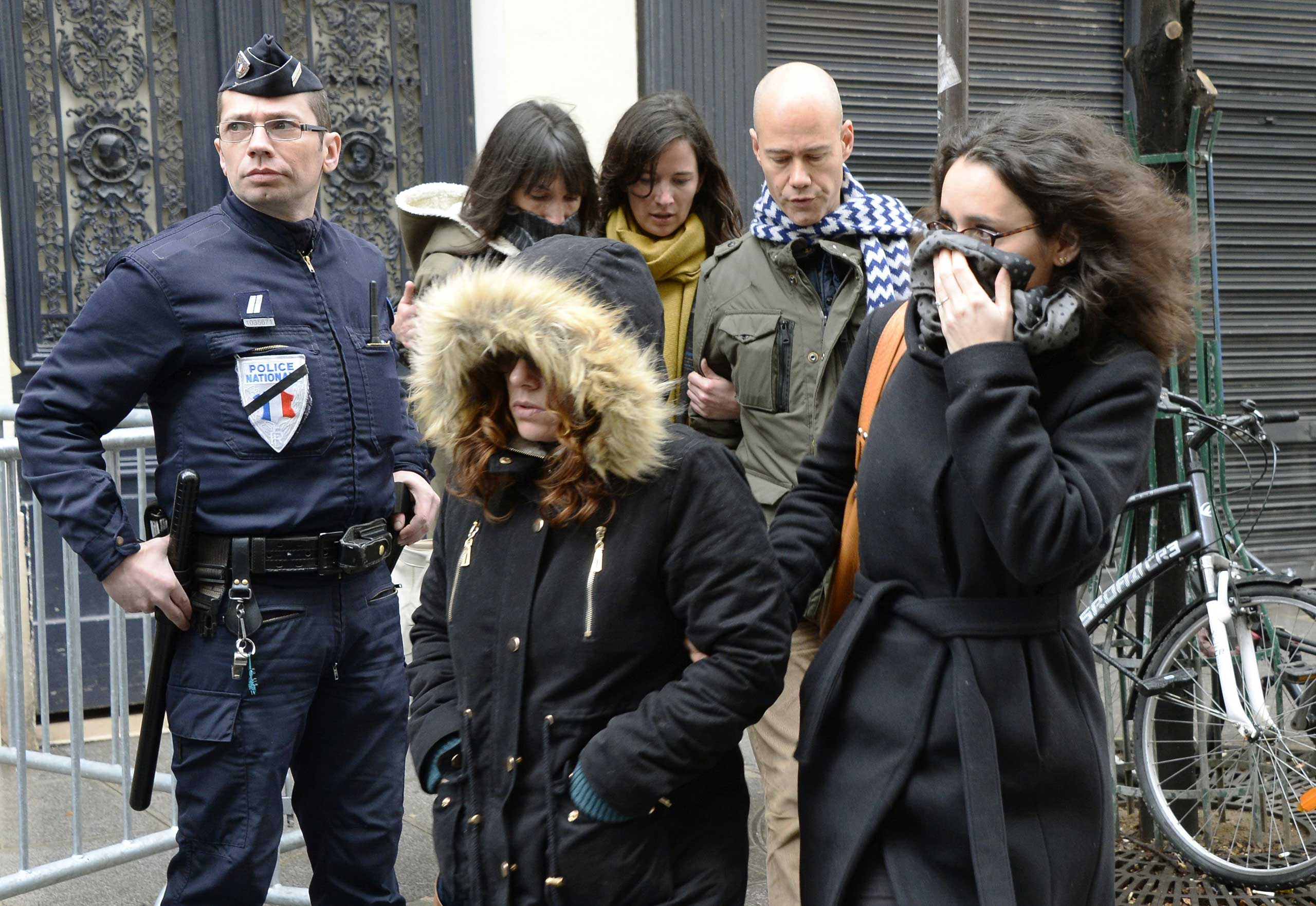 Staff arrive to attend an editorial meeting of French satirical weekly newspaper Charlie Hebdo and Liberation, Jan. 9, 2015 in Paris.