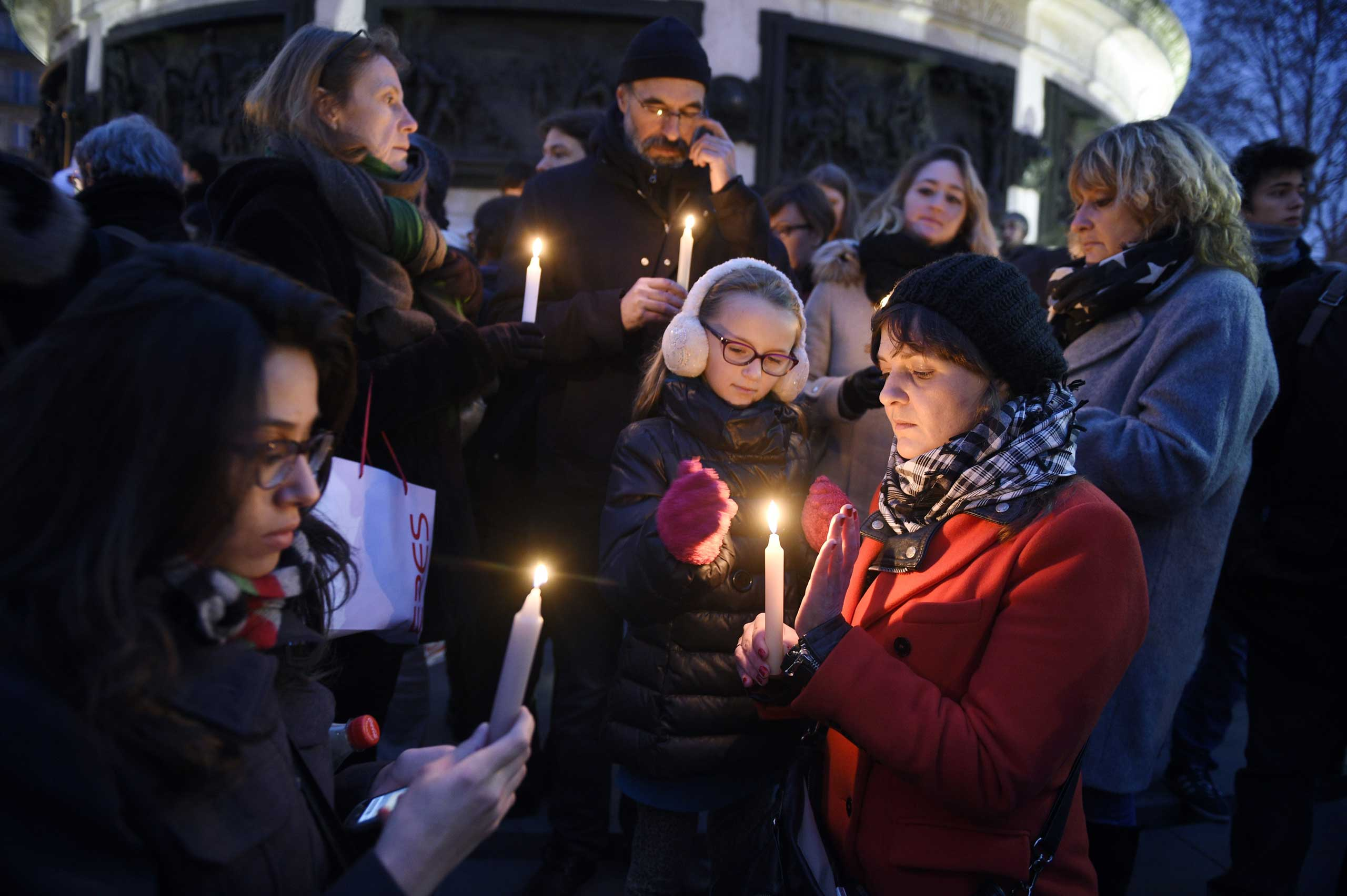 People light candles during a rally in support of the victims of the attack by gunmen at French satirical newspaper Charlie Hebdo at the Place de la Republique in Paris, on Jan. 7, 2015.