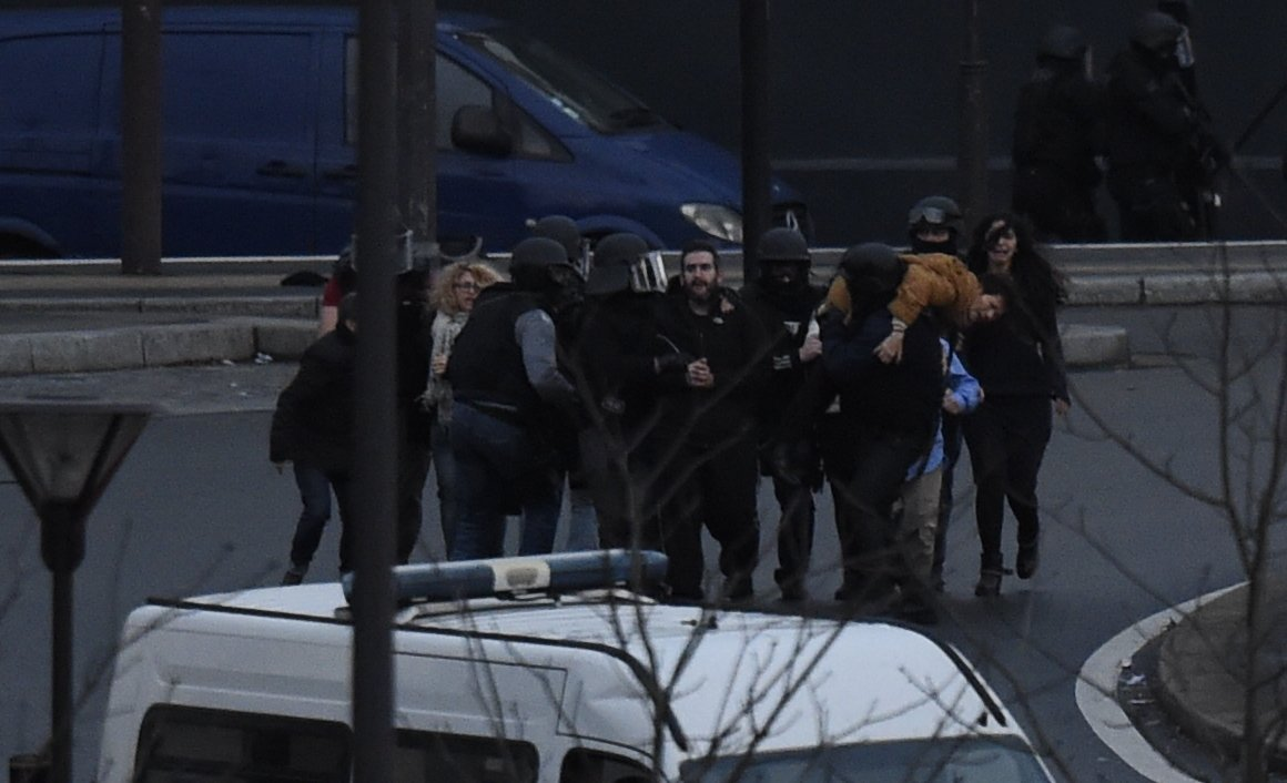 The moment when members of the French anti-terror forces RAID storm the kosher store where Amedy Coulibaly, an islamist gunman holds hostages, on Cours de Vincennes in Paris, on Jan. 9, 2015.
