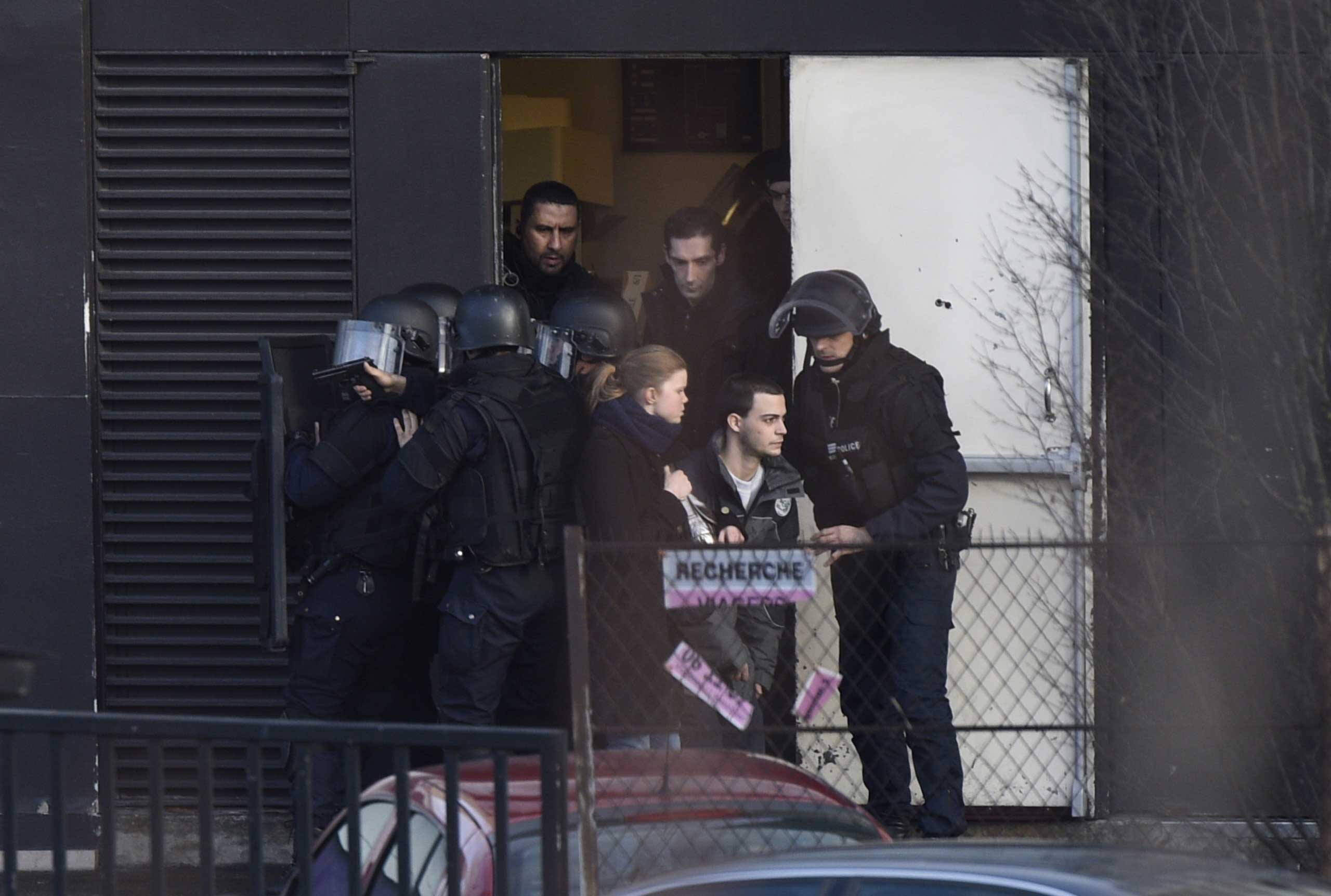 French police special forces evacuate local residents on Jan. 9, 2015 in Saint-Mande, near Porte de Vincennes, eastern Paris.