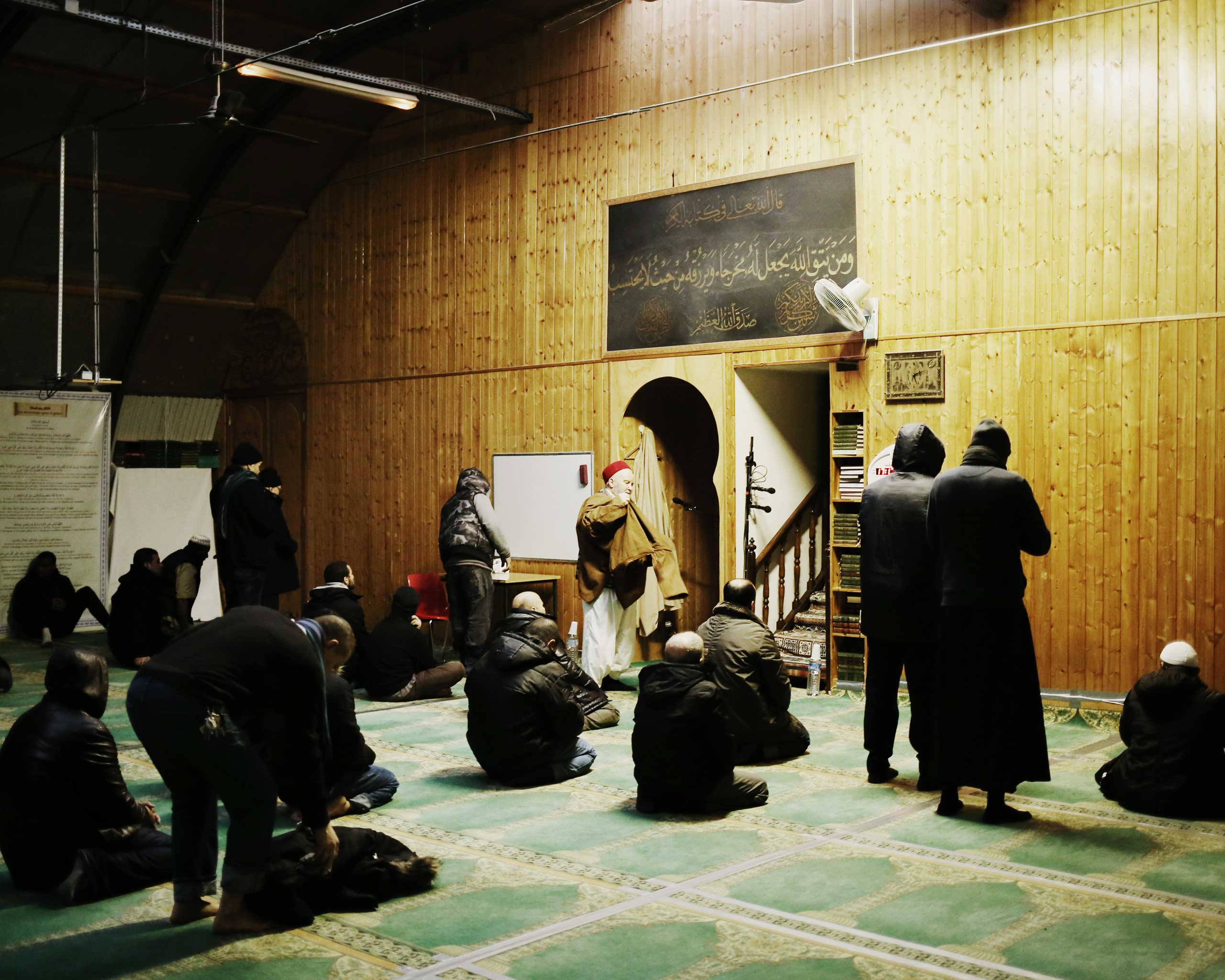 Men pray at a mosque in the 19th arrondissement in Paris, which the Kouachi brothers, the Charlie Hebdo attackers, had once attended, Jan. 13, 2015.
