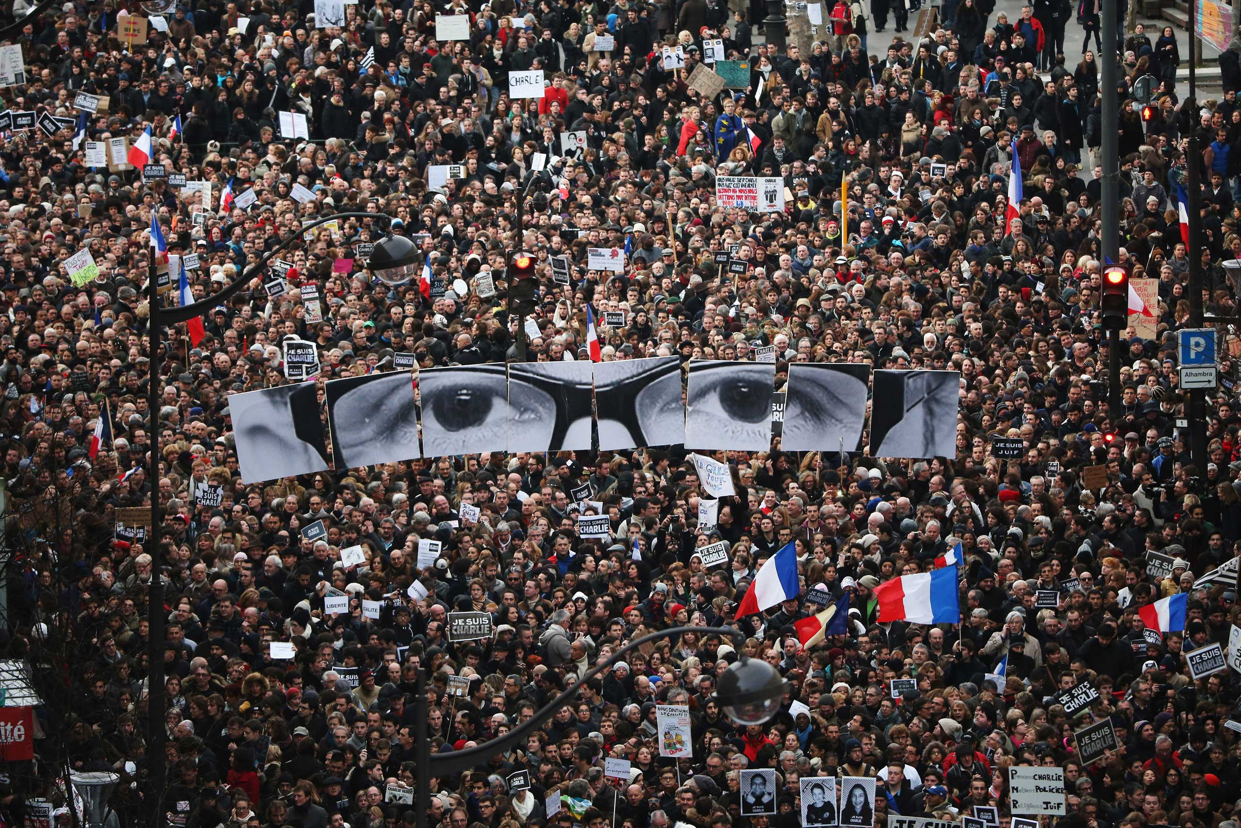 Demonstrators make their way along Boulevrd Voltaire in a unity rally in Paris following the recent terrorist attacks on Jan. 11, 2015 in Paris.