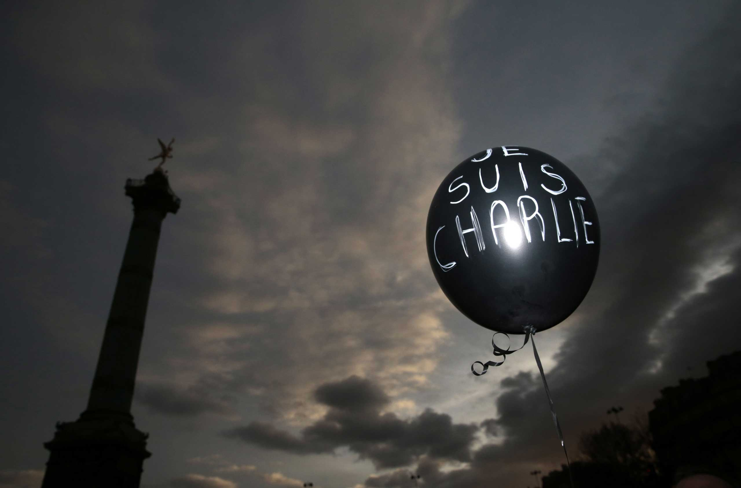 """A balloon reading """"Je suis Charlie"""" (I am Charlie) is held at Place de la Bastille during the solidarity march on Jan. 11, 2015 in Paris."""