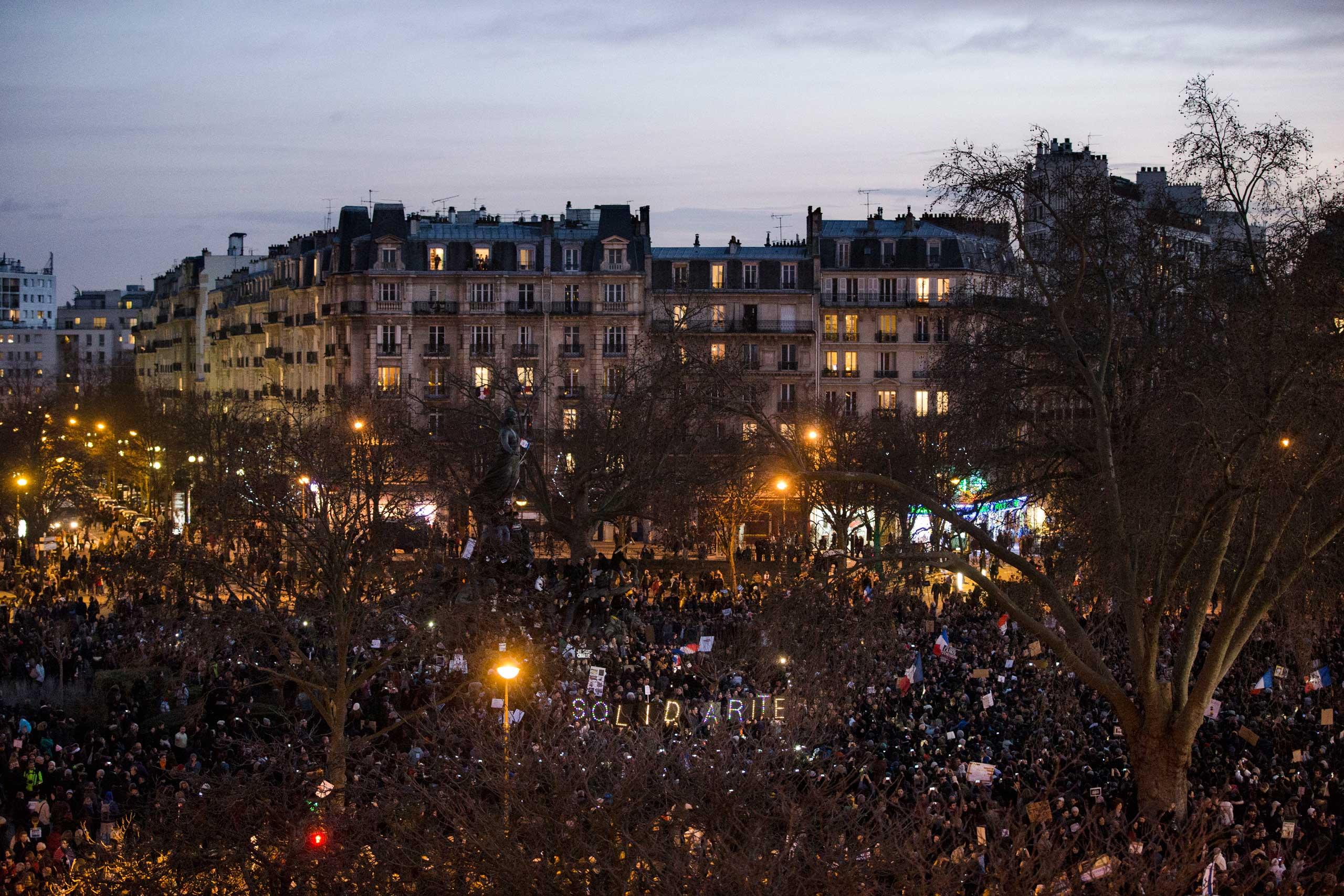 People gather at the Place de la Nation in Paris, Jan. 11,  2015.