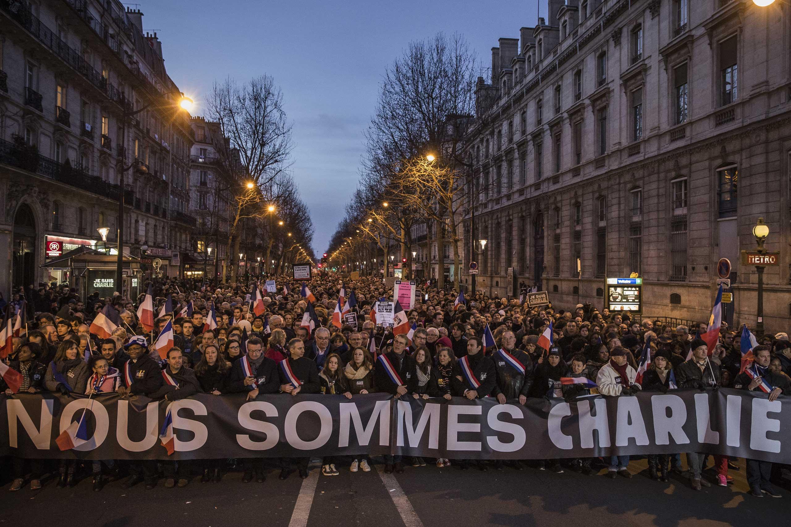 Demonstrators make their way along Place de la République during a mass unity rally following the recent terrorist attacks on Jan. 11, 2015 in Paris.