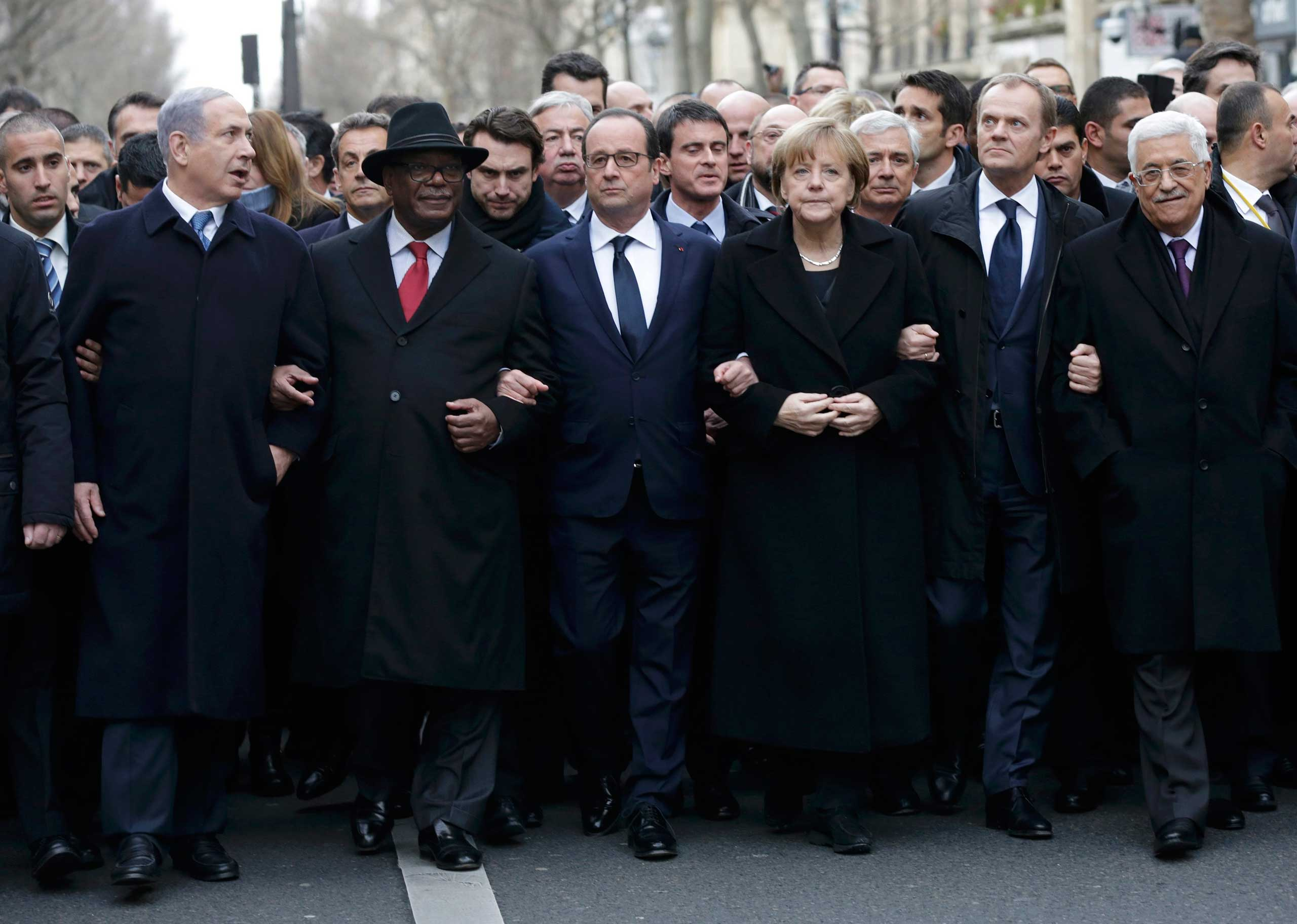 French President Francois Hollande is surrounded by head of states including Israel's Prime Minister Benjamin Netanyahu, Mali's President Ibrahim Boubacar Keita, Germany's Chancellor Angela Merkel, European Council President Donald Tusk and Palestinian President Mahmoud Abbas as they attend the solidarity march in the streets of Paris Jan. 11, 2015.
