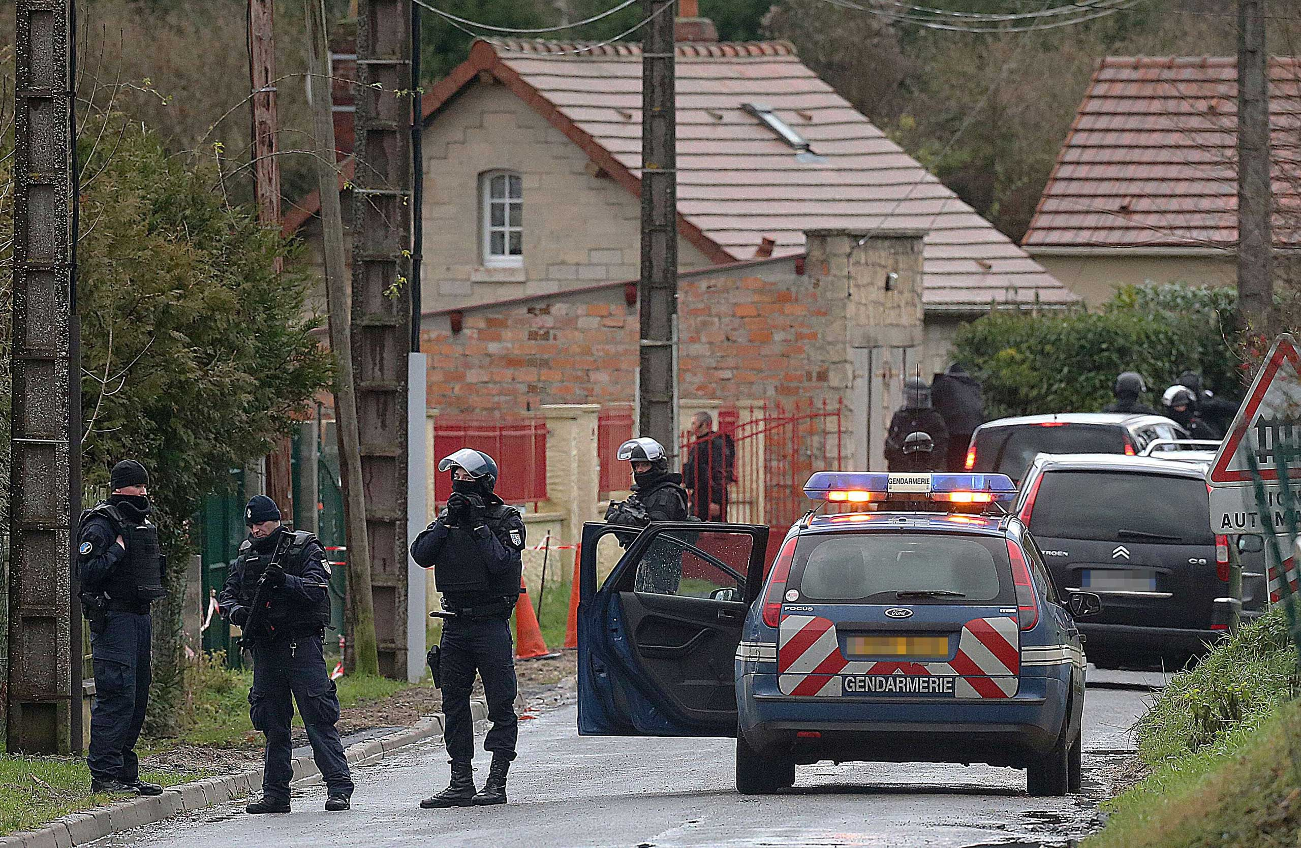 Members of GIPN and of RAID, French police special forces, are pictured in Corcy, near Villers-Cotterets, north-east of Paris, on Jan. 8, 2015, where the two armed suspects from the attack on French satirical weekly newspaper Charlie Hebdo were spotted in a gray Clio.