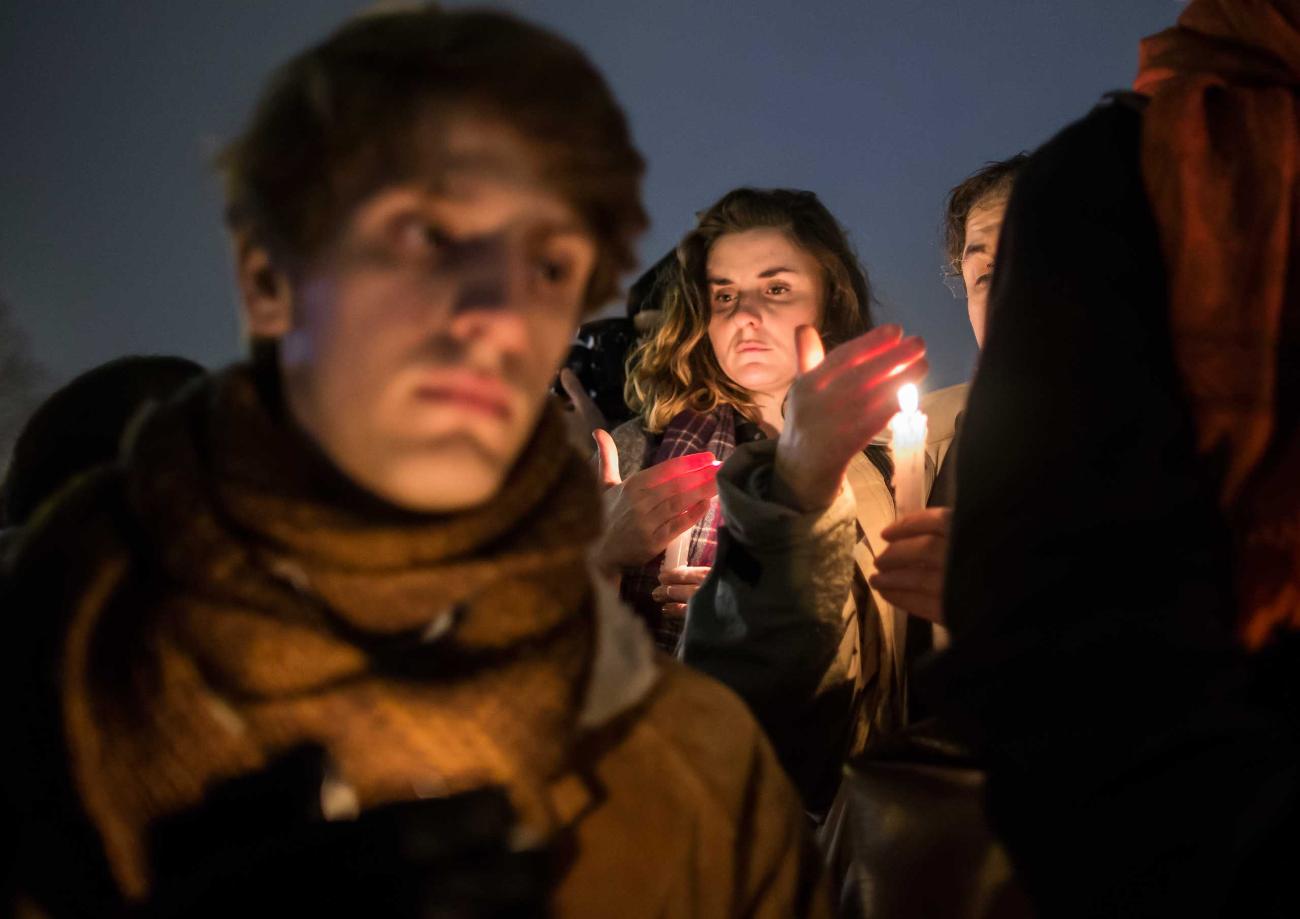 People hold a candle-light vigil as thousands gather silently on Place de la Republique in central Paris hours after the attack by masked gunmen on the <i>Charlie Hebdo</i> headquarters in Paris on  Jan. 7, 2015