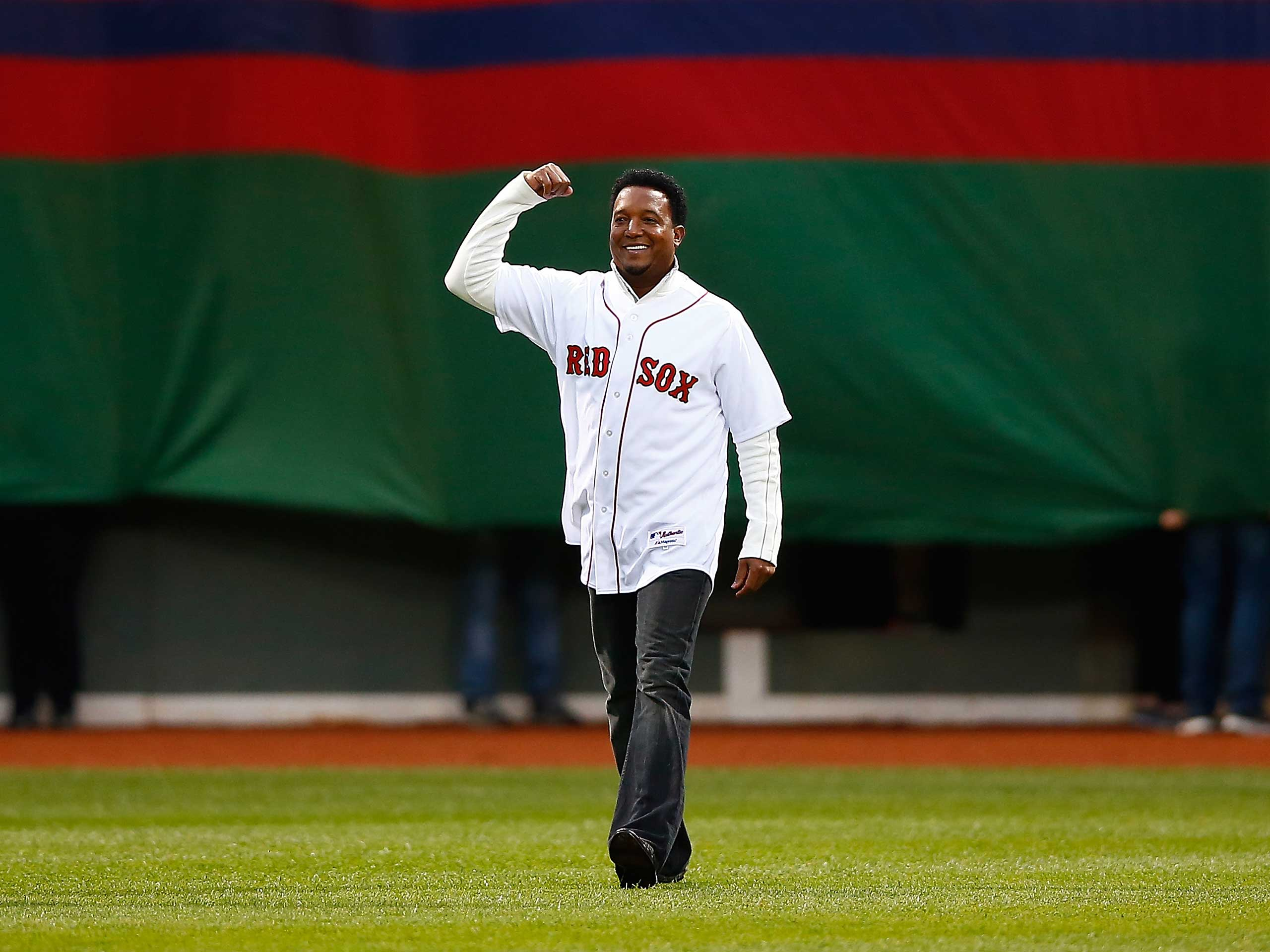 Former Boston Red Sox player Pedro Martinez is honored prior to the game between the Boston Red Sox and Atlanta Braves at Fenway Park in Boston on May 28, 2014.