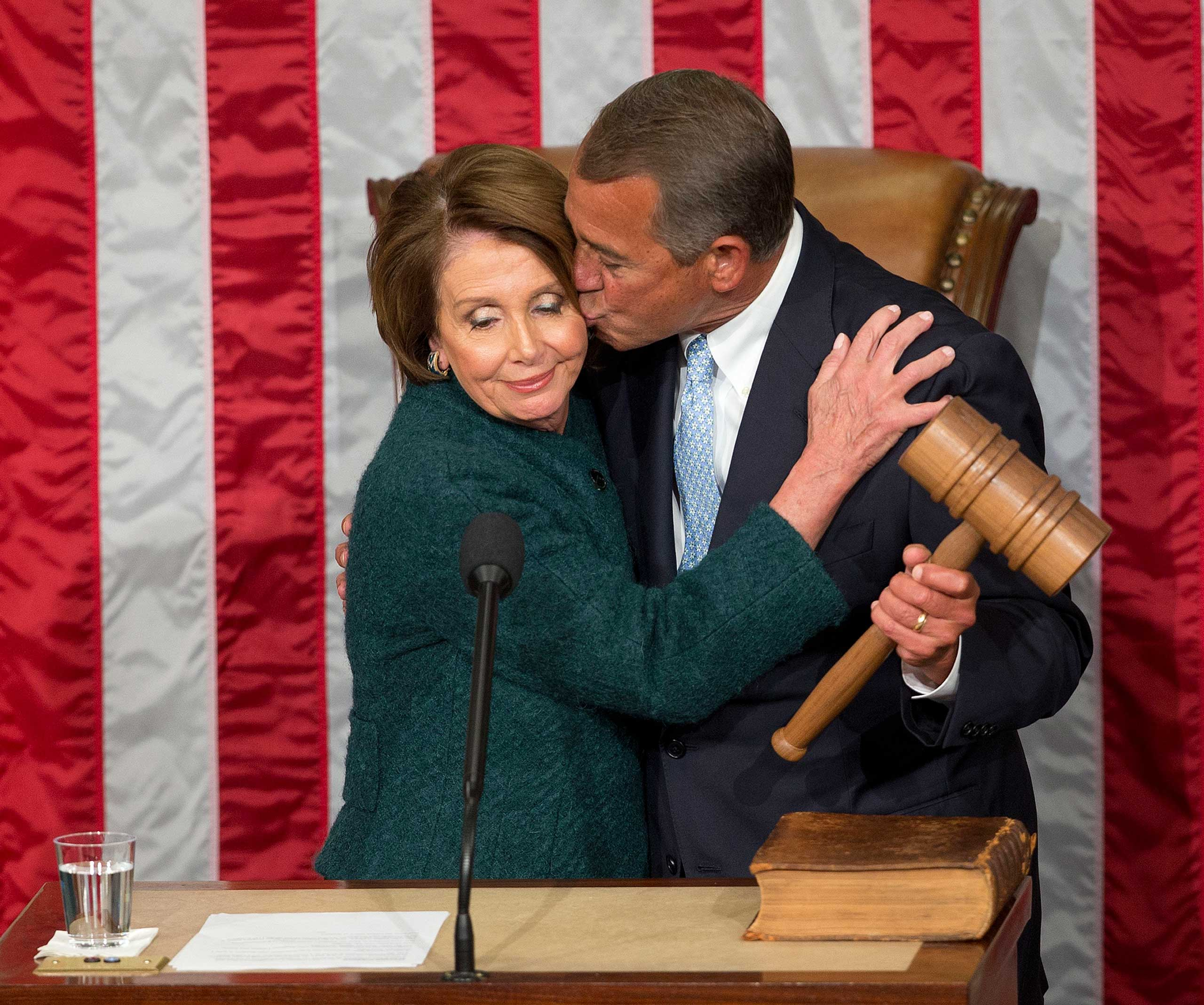 House Speaker John Boehner of Ohio, kisses House Minority Leader Nancy Pelosi of Calif. after being re-elected to a third term during the opening session of the 114th Congress on Capitol Hill in Washington on Jan. 6, 2015.