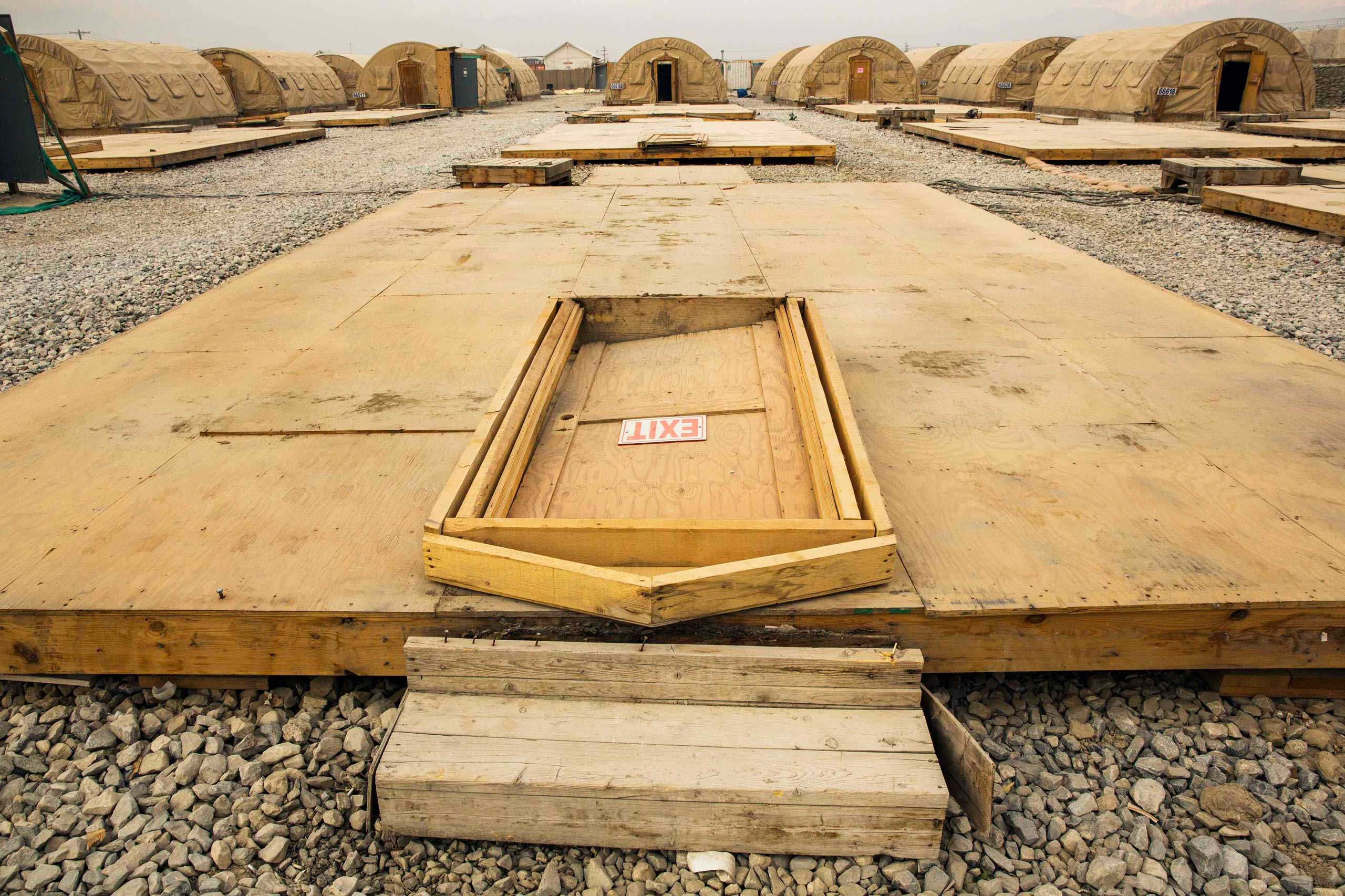 Jan, 2, 2015. A door rests on the floor of a dismantled tent at the Bagram Air Field in the Parwan province of Afghanistan. The base is being shrunk by demolishing large swaths of housing in order to hold roughly 13,000 foreign troops.