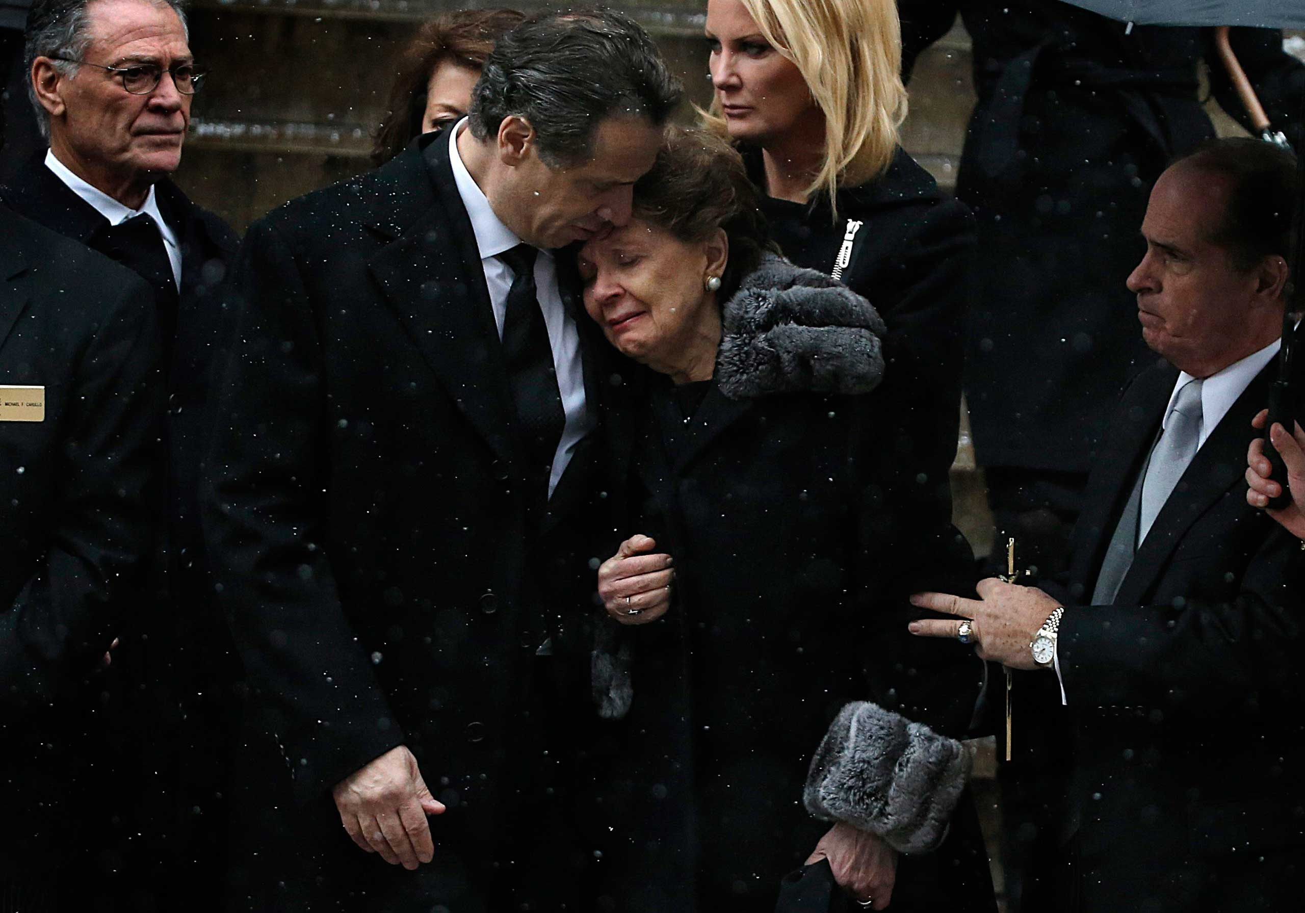 Jan. 6, 2015. New York Governor Andrew Cuomo comforts his mother Matilda outside the St. Ignatius Loyola Church after a funeral service for his late father, former Governor Mario Cuomo, in New York.