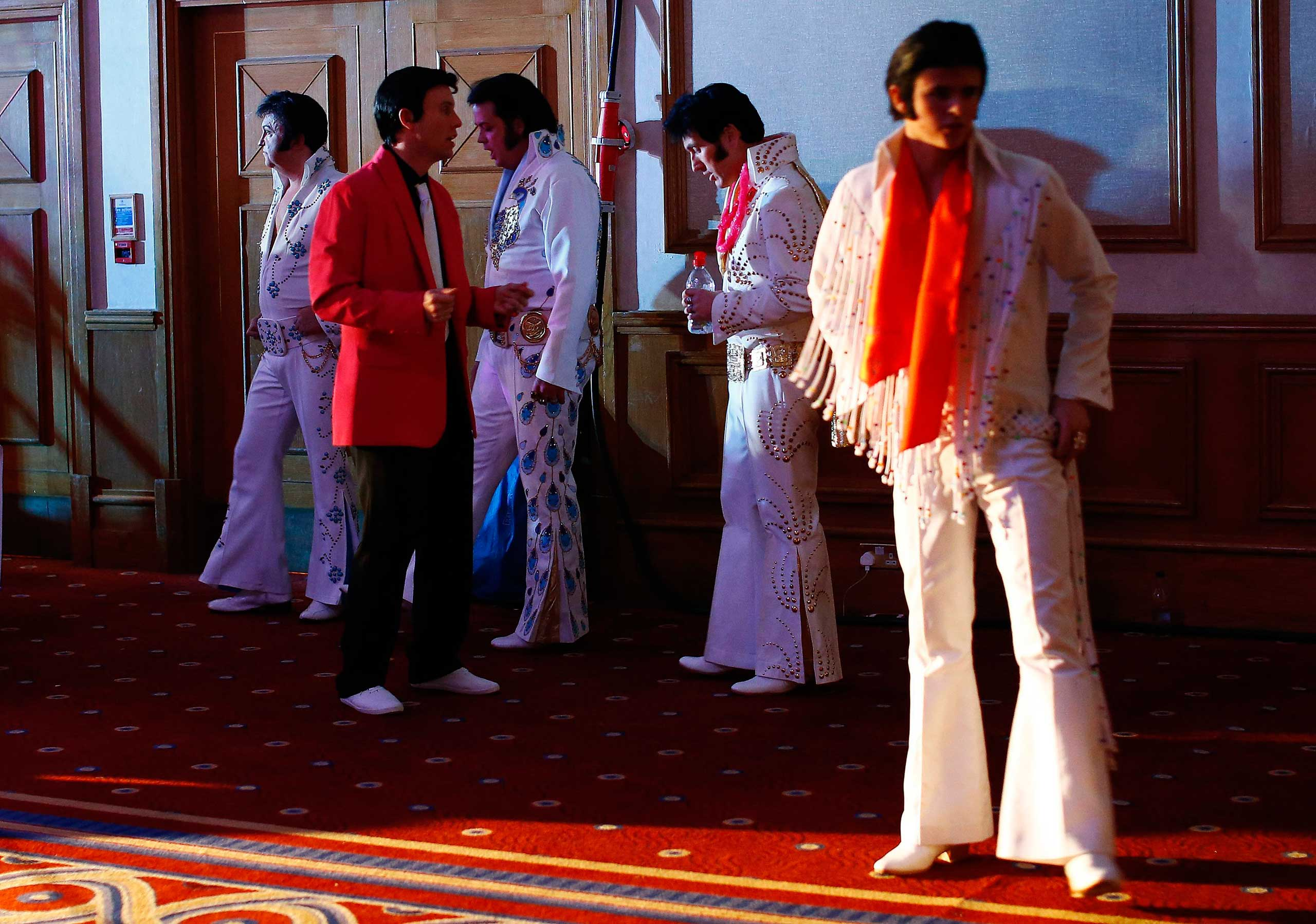 Jan. 4, 2015. Finalists wait backstage before their performances during the annual European Elvis Tribute Artist Contest and Convention in Birmingham, England.
