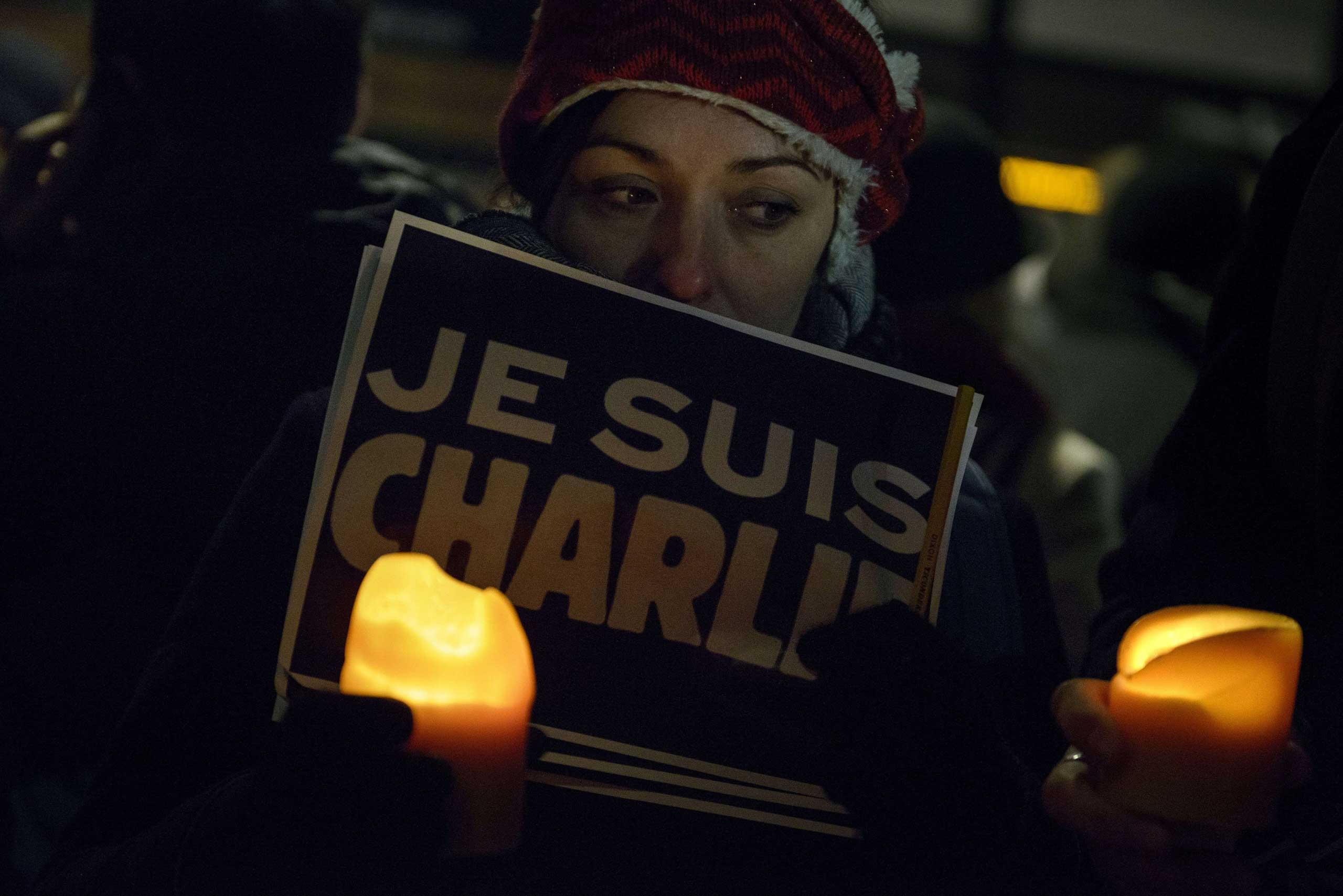Jan. 7, 2015. People hold posters with the words  Je Suis Charlie   (I Am Charlie) outside the Newseum  in Washington, D.C.