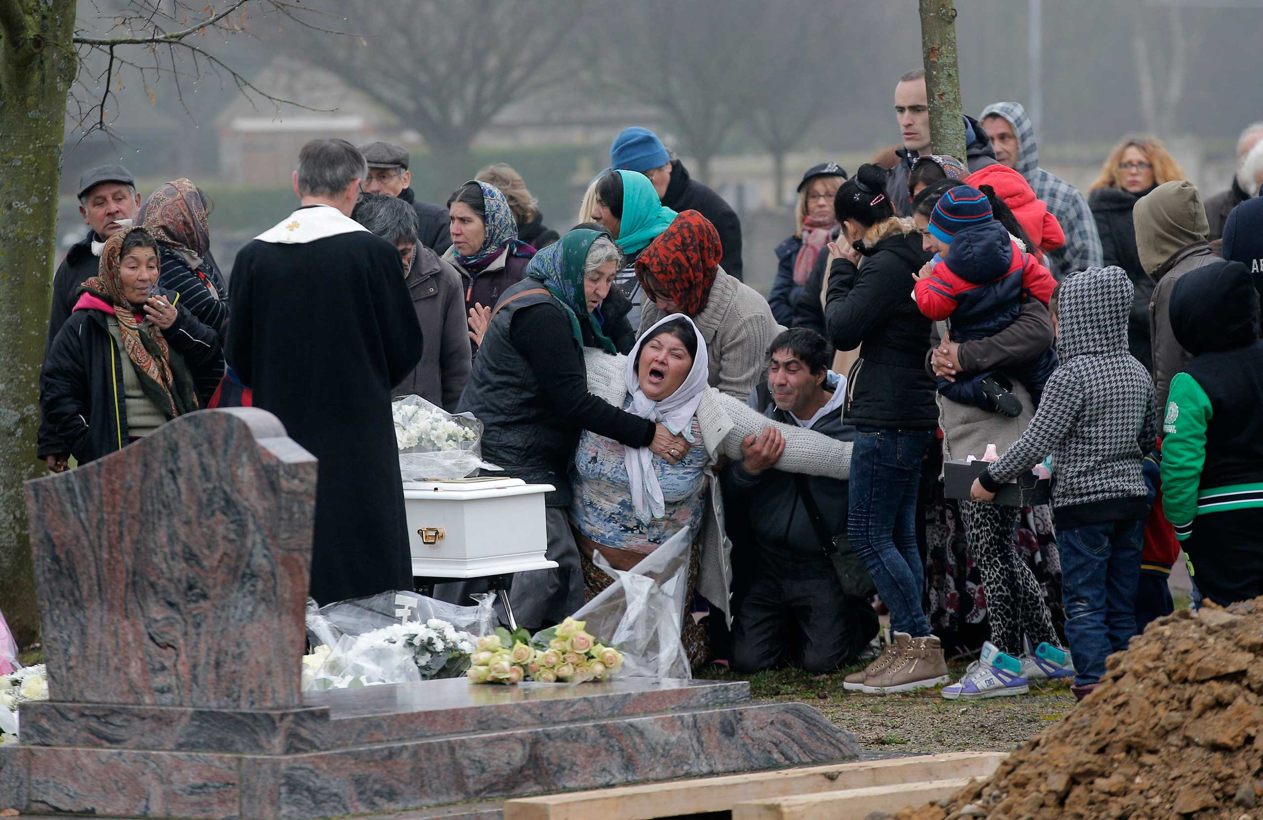 Jan. 5, 2015. The mother of Maria Francesca, who died of sudden infant death syndrome, cries in front of the coffin of her baby during the funeral in Wissous, outside Paris.